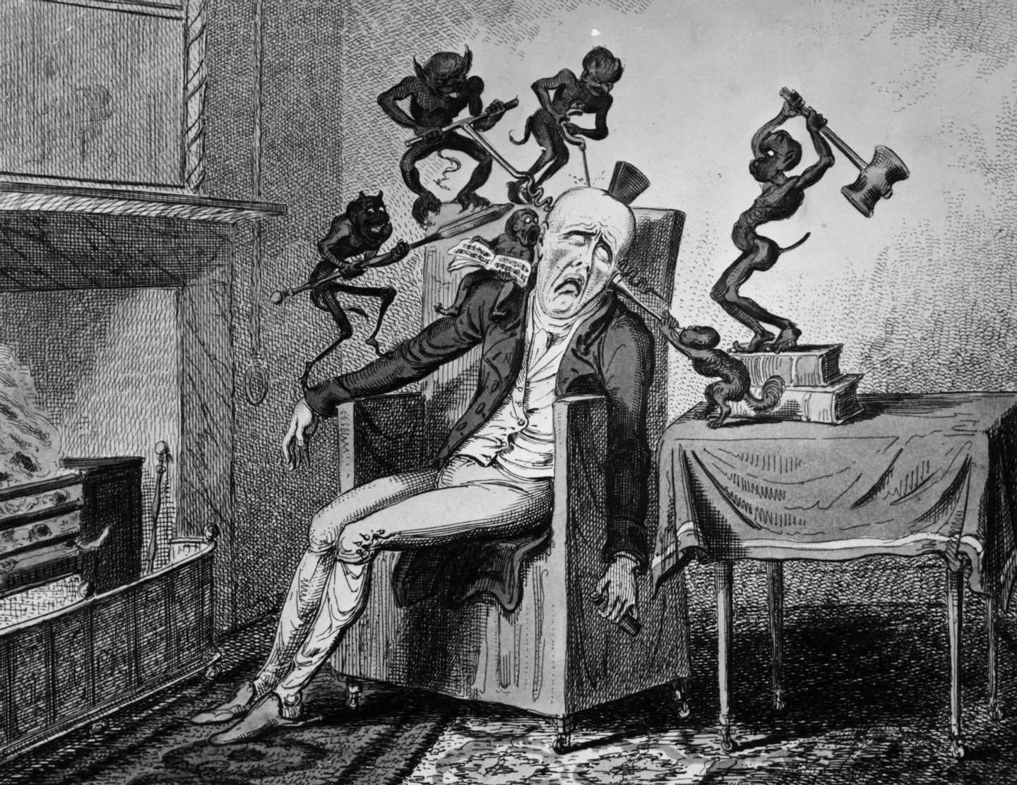 1819:  A man suffering from a headache is tormented by a horde of little demons.  'Headache' by Cruikshank.  (Photo by Hulton Archive/Getty Images)
