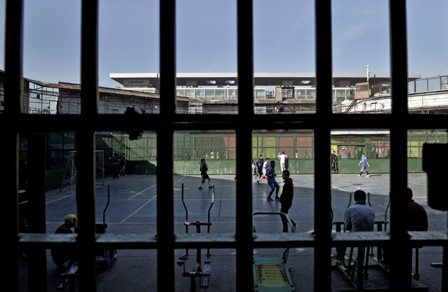 View of the yard of the penitentiary of Santiago, Chile on August 13, 2014. Wearing three-piece suits and carrying bibles, a group of evangelists are reforming Chilean prisons. They claim their visits to prisoners have resulted in many conversions to evangelism and that the recidivism has decreased. AFP PHOTO/MARTIN BERNETTI        (Photo credit should read MARTIN BERNETTI/AFP/Getty Images)
