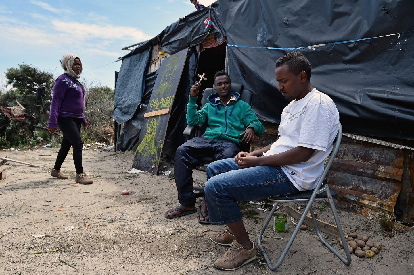 CALAIS, FRANCE - JUNE 25:  Migrants are seen in a make shift camp known as the 'New Jungle' on June 25, 2015 in Calais, France. Many migrants are camped in Calais on the side of the motorways as they attempt to board trucks stuck in slow moving traffic in the hope of making it into the UK.  (Photo by Jeff J Mitchell/Getty Images)