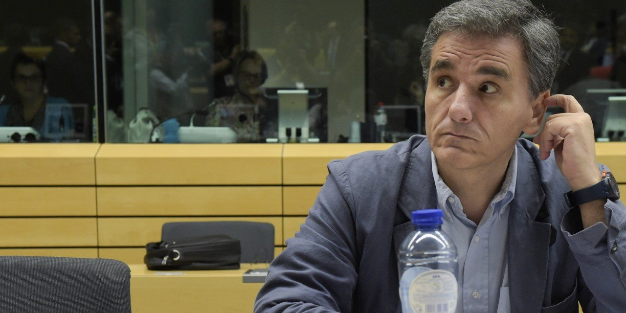 Newly appointed Greek Finance Minister Euclid Tsakalotos looks on during a Eurogroup meeting ahead of a Eurozone Summit meeting at the EU headquarters in Brussels on July 7, 2015. AFP PHOTO/ JOHN THYS (Photo credit should read JOHN THYS/AFP/Getty Images)