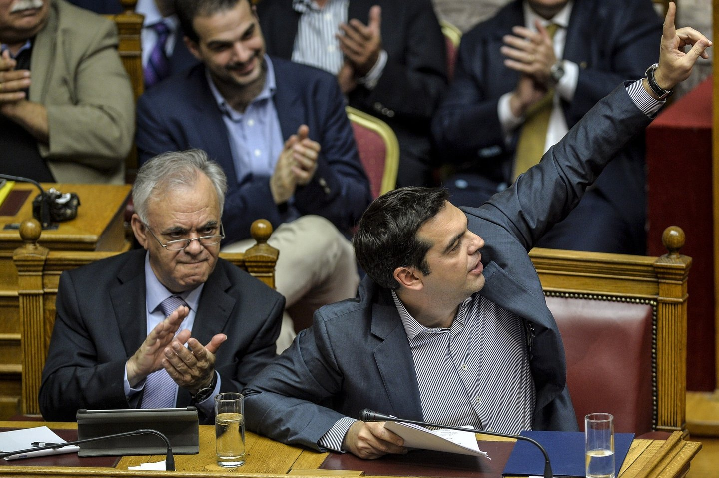 Greek Prime Minister Alexis Tsipras (R) gestures at a joint session of four committees of the Parliament (Economic, Social, Public Administration and Production and Trade) at the Greek Parliament in Athens on July 10, 2015. Lawmakers in Greece are to vote whether to back a last-ditch reform plan the government submitted to creditors overnight in a bid to stave off financial collapse and exit from the Eurozone. Greece's international creditors believe its latest debt proposals are positive enough to be the basis for a new bailout worth 74 billion euros, an EU source said June 10. AFP PHOTO/ANDREAS SOLARO        (Photo credit should read ANDREAS SOLARO/AFP/Getty Images)