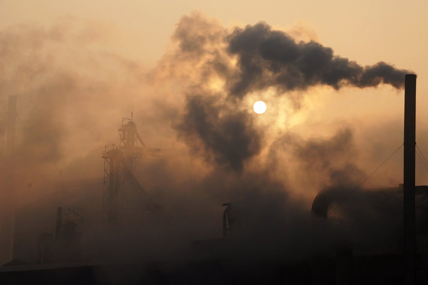 This picture taken on January 17, 2013 shows a cement factory releasing heavy smoke in Binzhou, in eastern China's Shandong province. China's economy grew at its slowest pace in 13 years in 2012, the government said on January 18, but an uptick in the final quarter pointed to better news ahead for a prime driver of the tepid global recovery.  CHINA OUT     AFP PHOTO        (Photo credit should read STR/AFP/Getty Images)