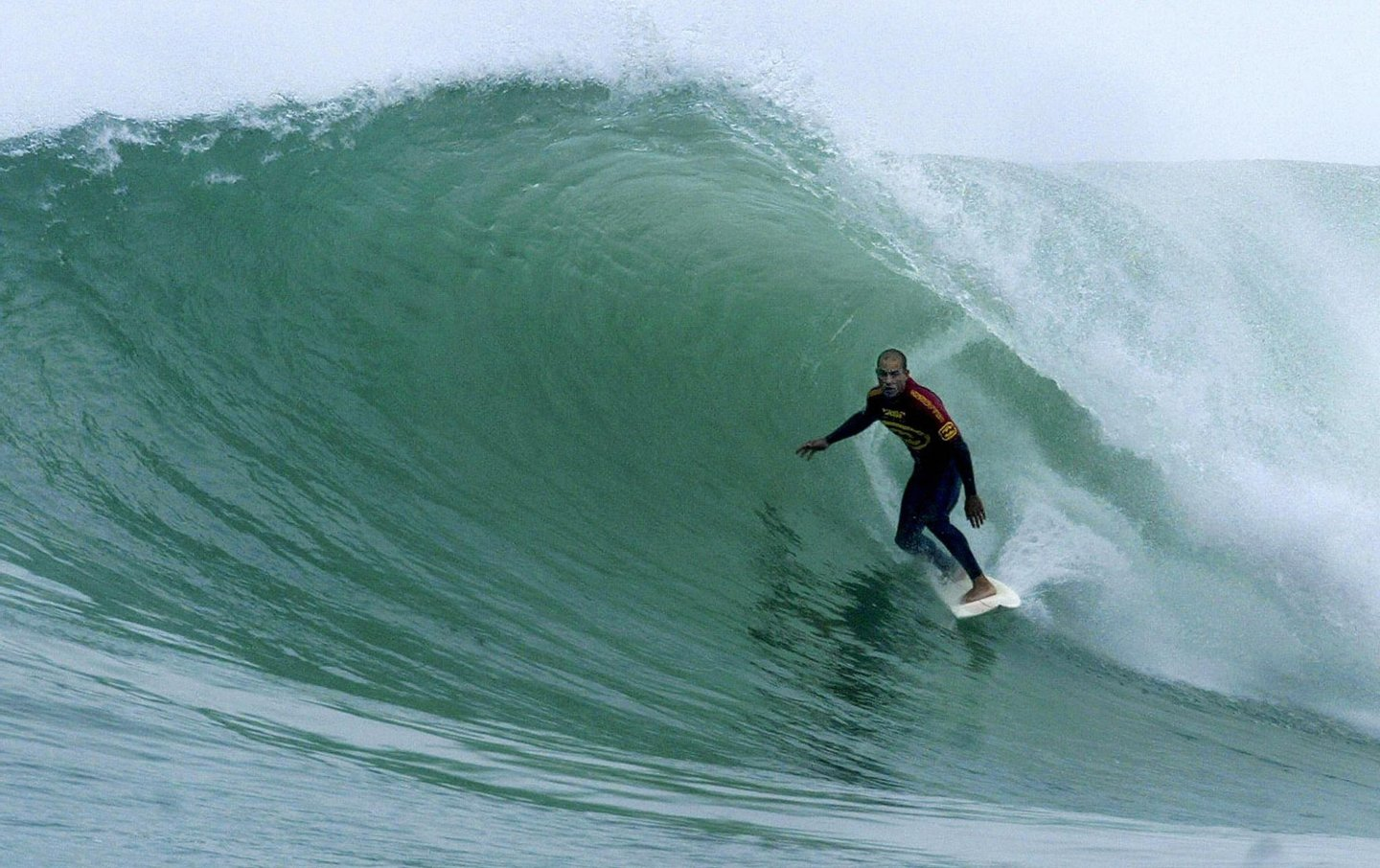 Kelly Slater of the US rides a wave in round three of the Billabong Pro at Jeffreys Bay in South Africa, 20 July 2003. Slater dominated his heat against Lee Winkler of Australia posting a near perfect 19.50 (out of 20 points) heat tally, the highest of the event to date and his best single heat score of the year, to advance to round four.   AFP PHOTO/Grant ELLIS/Tostee.com/HO  (Photo credit should read GRANT ELLIS/AFP/Getty Images)