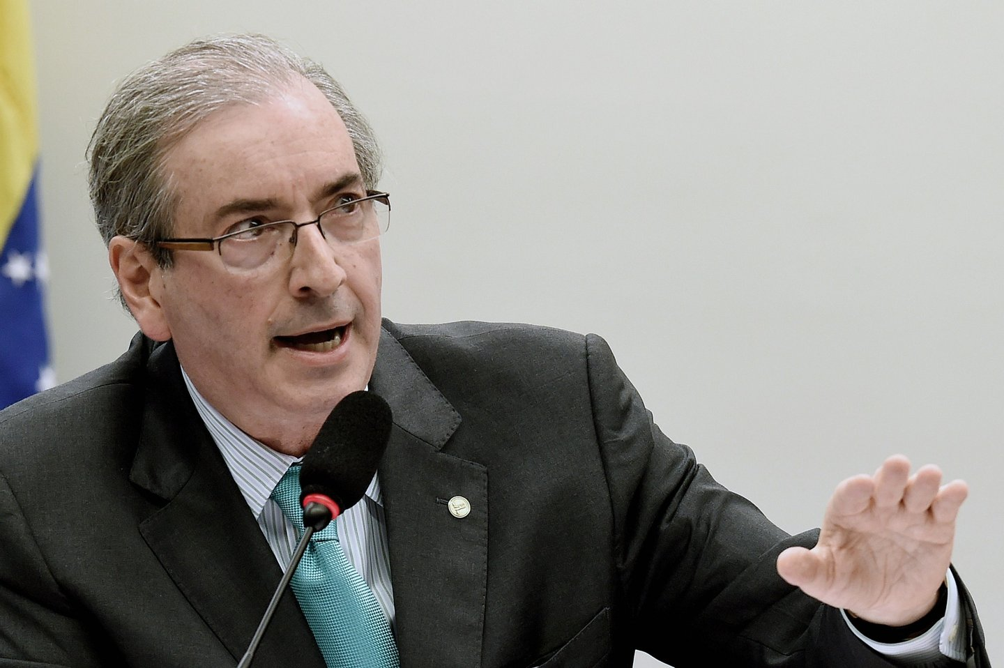 Chamber of Deputies President Eduardo Cunha of the Brazilian Democratic Movement Party (PMDB) speaks during a hearing with the Parliamentary Commission of Inquiry that investigates accusations of corruption in Petrobras, in Brasilia on March 12, 2015. Dozens of politicians from five parties, including from that of Brazilian President Dilma Rousseff, have been implicated in a corrupt network which laundered $4 billion of Brazil's state oil giant money. AFP PHOTO/EVARISTO SA        (Photo credit should read EVARISTO SA/AFP/Getty Images)