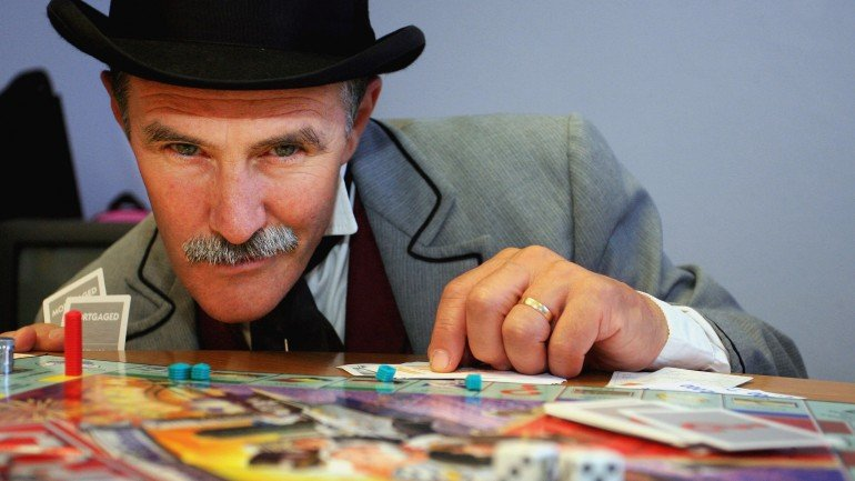 SYDNEY, AUSTRALIA - JUNE 05: Jeremy Johnson from Sovereign Hill Museums plays the new look Australian Here and Now Monopoly board at Hasbro's Head Office on June 5, 2007 in Sydney, Australia. 16.8 million votes determined which 22 regions made it onto the all new Australian Monopoly Here & Now board. (Photo by Lisa Maree Williams/Getty Images)