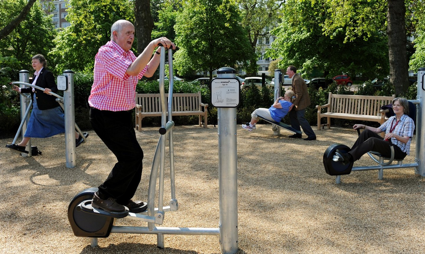 Winston Fletcher (2nd L) uses an exercise machine alongside other elderly participants during the official opening of the first pensioners' playground in Hyde Park in London on May 19, 2010. The outdoor facility features fun fitness equipment that offers a range of exercises to improve strength and flexibility and help adults continue active and healthy lifestyles in later years. Play areas for older people are popular in China and parts of Europe, but this is the first of its kind in London. AFP PHOTO / Adrian Dennis (Photo credit should read ADRIAN DENNIS/AFP/Getty Images)