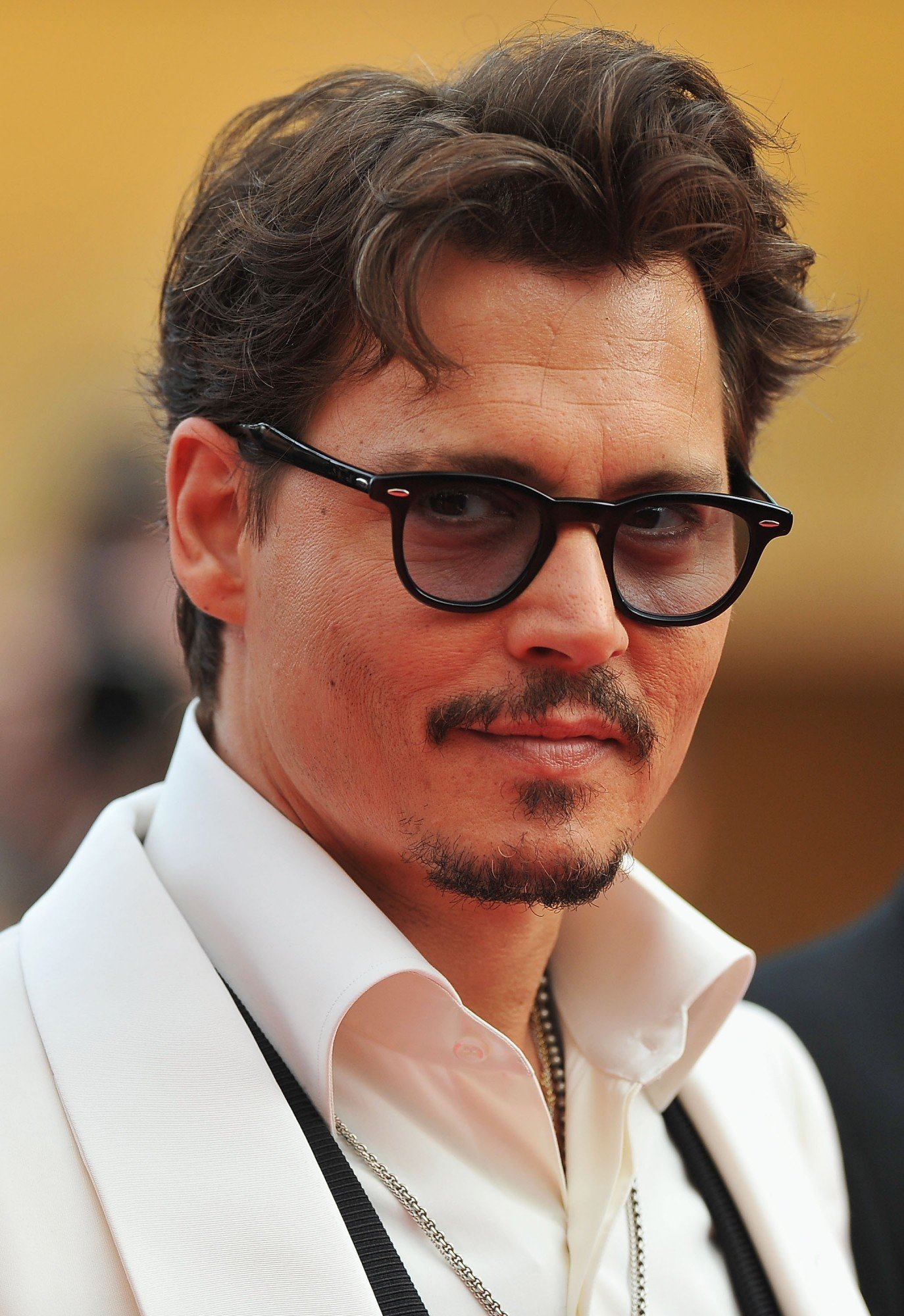 """CANNES, FRANCE - MAY 14: Actor Johnny Depp attends the """"Pirates of the Caribbean: On Stranger Tides"""" premiere at the Palais des Festivals during the 64th Cannes Film Festival on May 14, 2011 in Cannes, France. (Photo by Pascal Le Segretain/Getty Images)"""