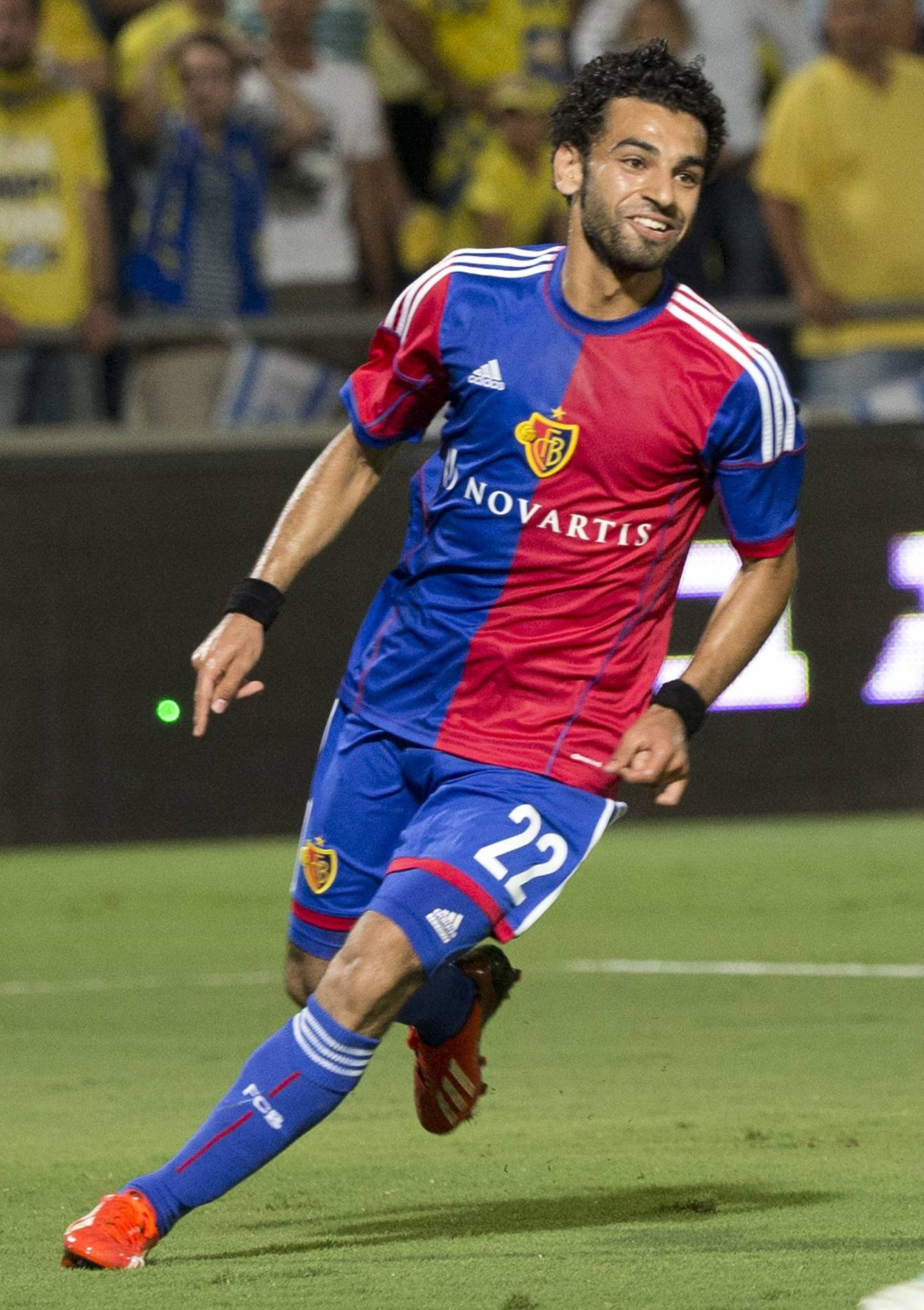 Switzerland's FC Basel midfielder Mohamed Sala celebrates after scoring against Maccabi Tel Aviv FC at the Bloomfield stadium in the coastal city of Tel Aviv on August 6, 2013 during the UEFA Champions League third qualifying round football match between Maccabi Tel Aviv and FC Basel. AFP PHOTO / JACK GUEZ (Photo credit should read JACK GUEZ/AFP/Getty Images)