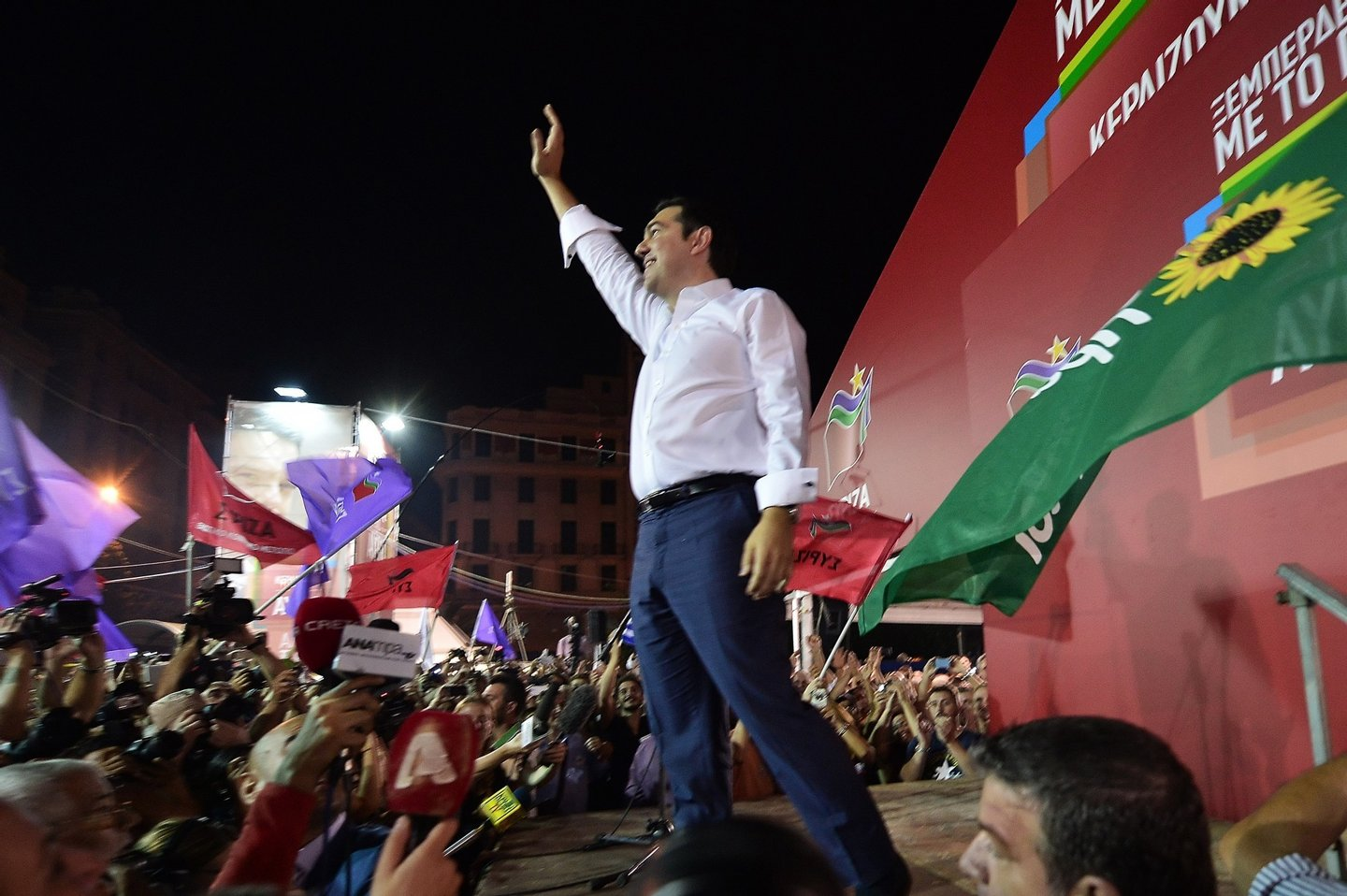 Syriza leader Alexis Tsipras celebrates with crowds after his party's victory at the Greek general elections in Athens on September 20, 2015. With over half of the votes counted, Tsipras' Syriza party won 35.54 percent of the vote against 28.07 percent for conservative New Democracy and is likely to again form a coalition government with the nationalist Independent Greeks (ANEL) party. AFP PHOTO/ LOUISA GOULIAMAKI (Photo credit should read LOUISA GOULIAMAKI/AFP/Getty Images)