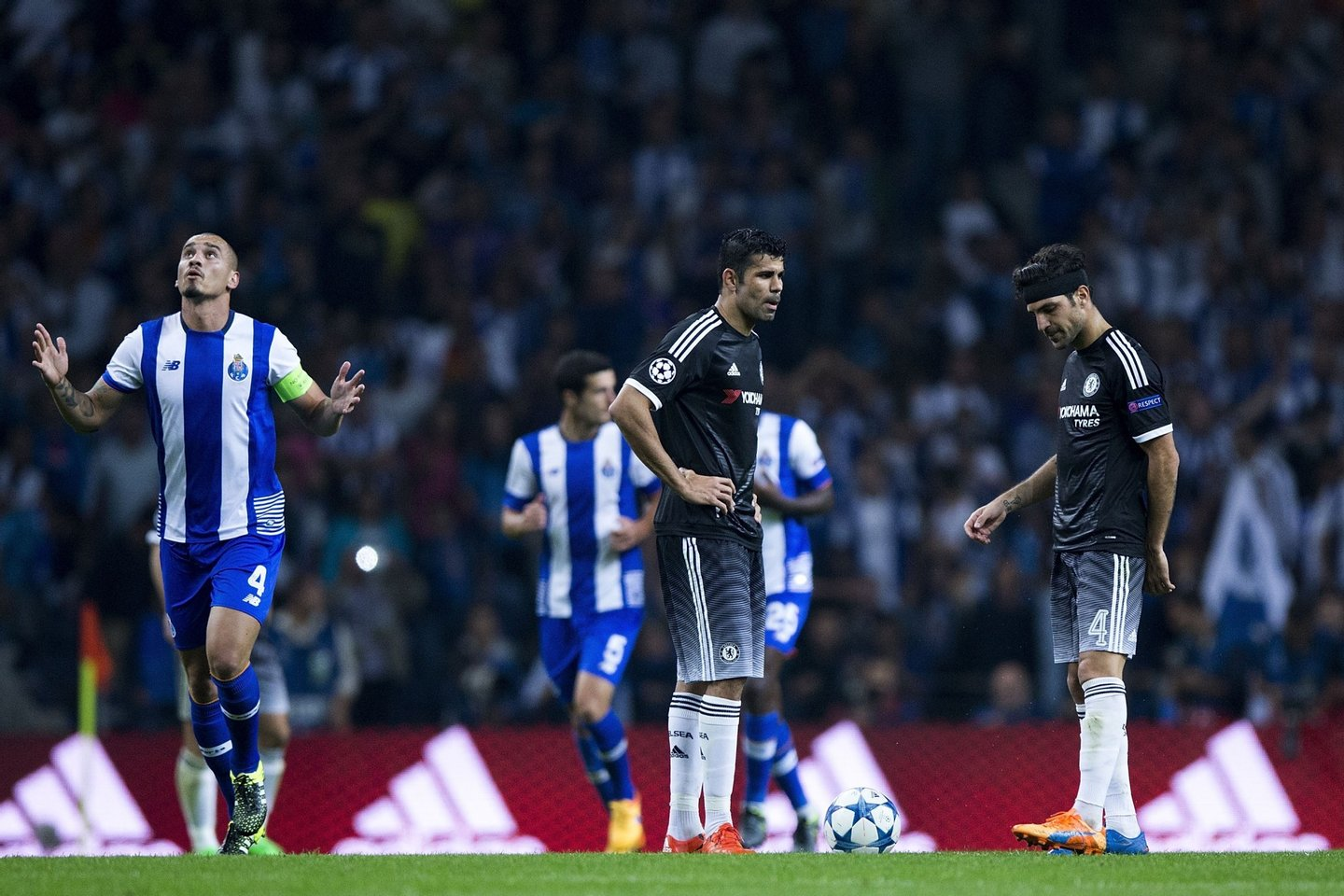 PORTO, PORTUGAL - SEPTEMBER 29: Diego Costa (2ndR) and his teammate Cesc Fabregas (R) react defeated as Maicon Pereira (L) of FC Porto celebrates his team's second goal during the UEFA Champions League Group G match between FC Porto and Chelsea FC at Estadio do Dragao on September 29, 2015 in Porto, Portugal. (Photo by Gonzalo Arroyo Moreno/Getty Images)