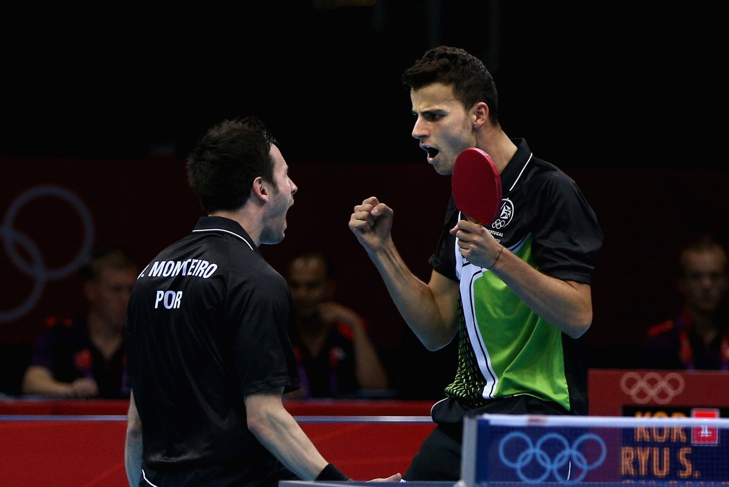 LONDON, ENGLAND - AUGUST 05: Joao Monteiro and Tiago Apolonia of Portugal celebrate during Men's Team Table Tennis quarterfinal match against team of Korea on Day 9 of the London 2012 Olympic Games at ExCeL on August 5, 2012 in London, England. (Photo by Feng Li/Getty Images)