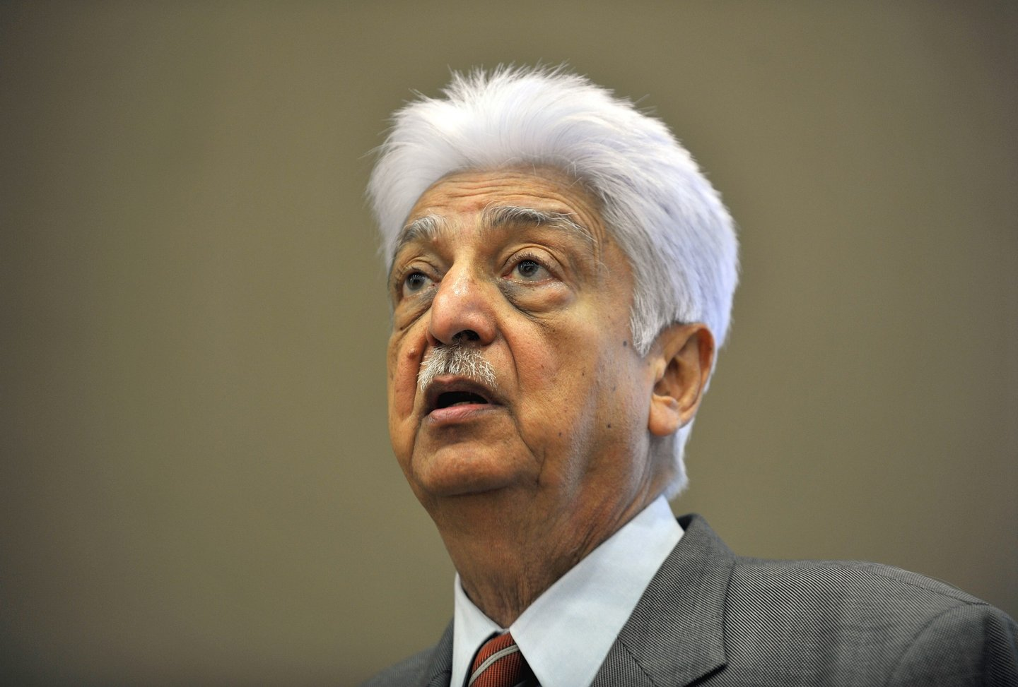 Indian Chairman of Wipro Limited, Azim Premji, speaks during a press conference held to announce the company's 2nd quarter results in Bangalore on November 2, 2012. India's third-largest outsourcing firm Wipro reported second-quarter net profit jumped 24 percent, thanks to stronger demand as customers sought to reduce costs in a weak global economy. AFP PHOTO/ Manjunath KIRAN (Photo credit should read Manjunath Kiran/AFP/Getty Images)