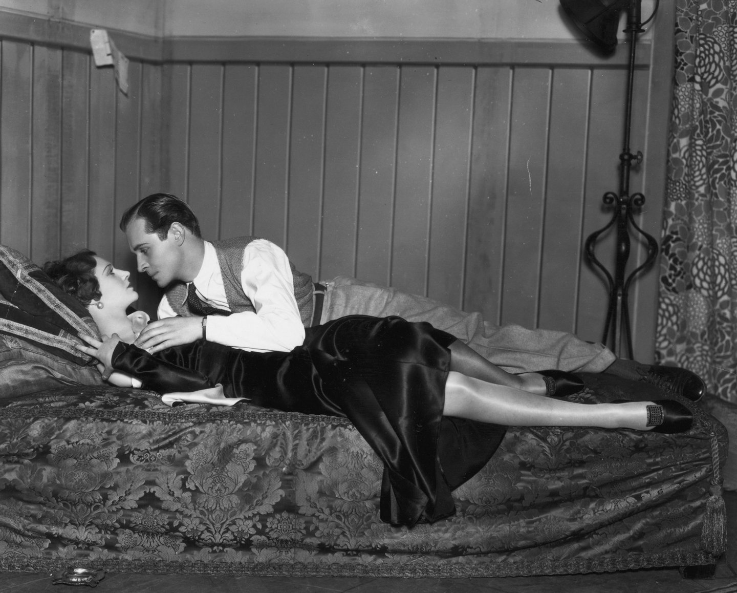 31st January 1931: Madeleine Carroll (1906 - 1987) and Robert Douglas play a love scene from the John Van Druten play 'After All' at the Criterion Theatre, London. (Photo by Sasha/Getty Images)