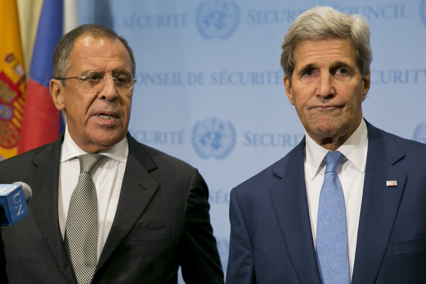 """United States Secretary of State John Kerry (R) and Russia Foreign Minister Sergey Lavrov speak to the media after a meeting concerning Syria at the United Nations headquarters in New York on September 30, 2015. Russia's air strikes in Syria targeted opposition forces and not Islamic State jihadists, a US defense official said, contradicting Russian claims. At the United Nations in New York, Secretary of State John Kerry made clear that Washington would have """"grave concerns"""" should Moscow opt to strike targets in areas where IS fighters and Al-Qaeda-linked groups are not operating. AFP PHOTO/Dominick Reuter (Photo credit should read DOMINICK REUTER/AFP/Getty Images)"""