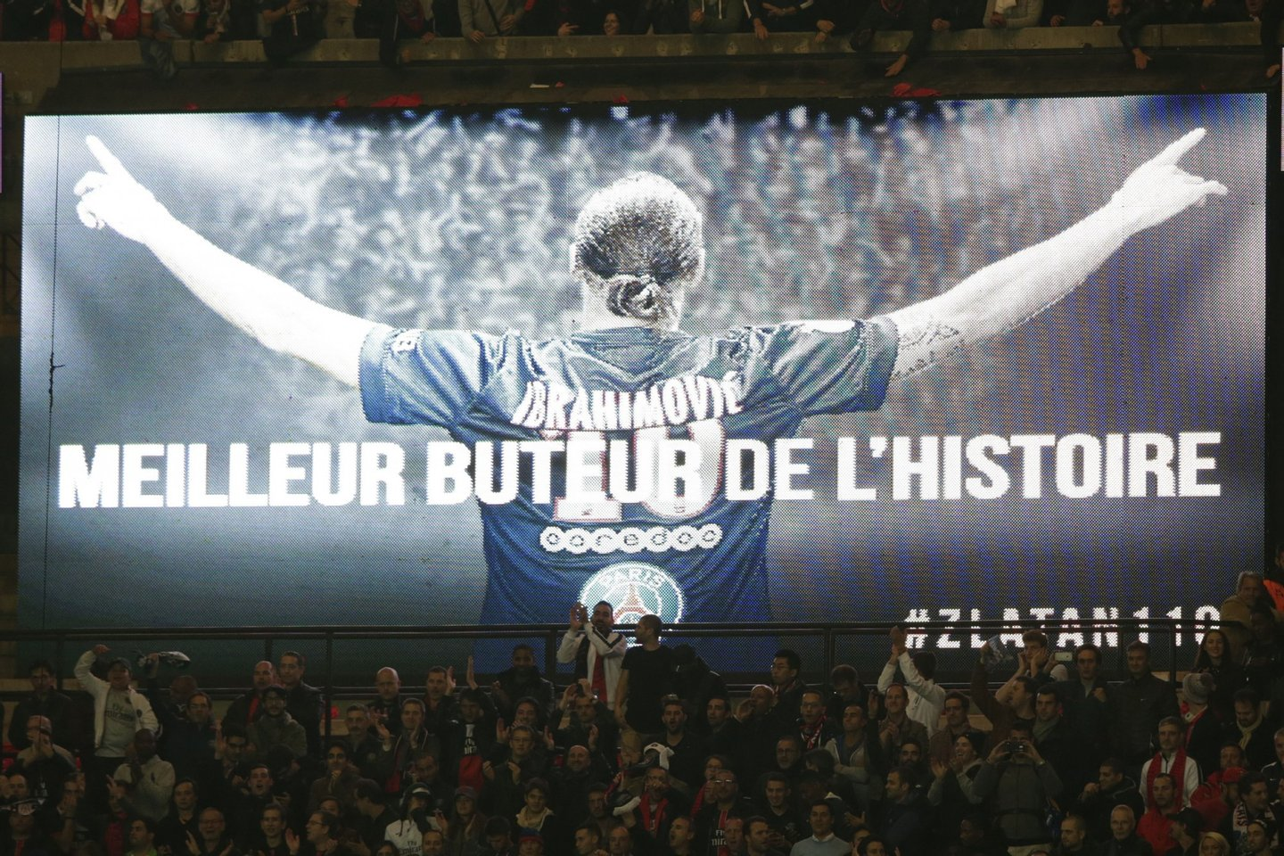 "A screen with a message reading ""Best striker in the history"" showing a picture Paris Saint-Germain's Swedish forward Zlatan Ibrahimovic is seen during the French L1 football match Paris Saint-Germain (PSG) vs Olympique de Marseille (OM) on October 4, 2015 at the Parc des Princes stadium in Paris. AFP PHOTO / KENZO TRIBOUILLARD (Photo credit should read KENZO TRIBOUILLARD/AFP/Getty Images)"