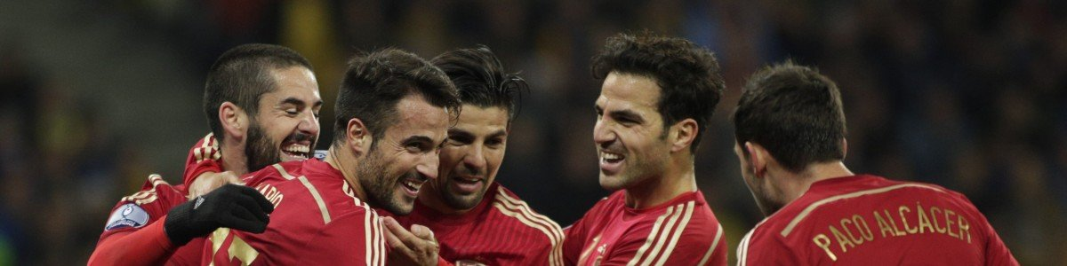 Spain's players celebrate after scoring during the Euro 2016 qualifying football match between Ukraine and Spain at Olympiysky stadium in Kiev on October 12, 2015. AFP PHOTO / ANATOLII STEPANOV (Photo credit should read ANATOLII STEPANOV/AFP/Getty Images)