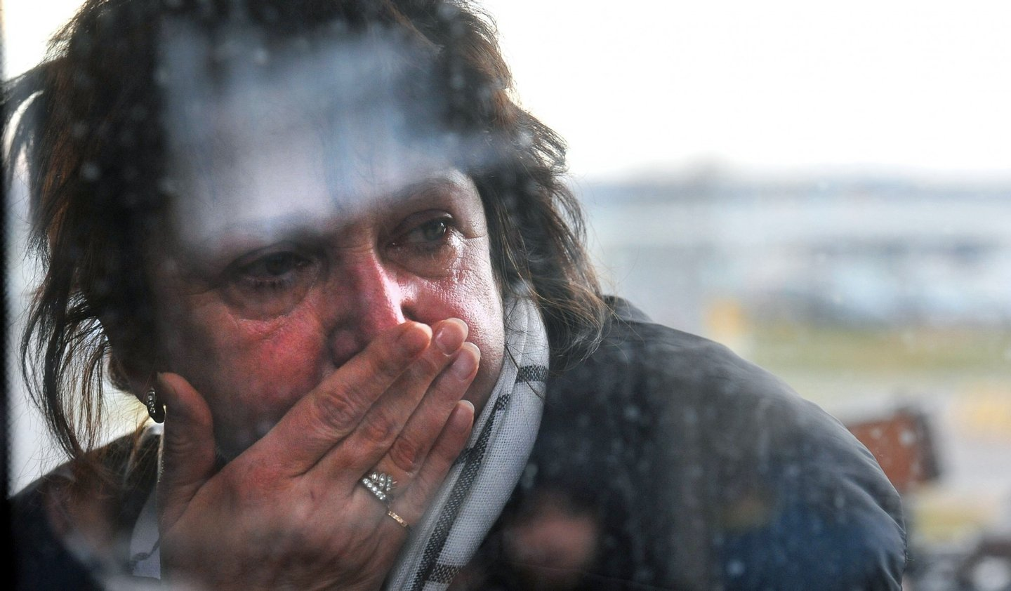 "A relative reacts at Pulkovo international airport outside Saint Petersburg after a Russian plane with 224 people on board crashed in a mountainous part of Egypt's Sinai Peninsula on October 31, 2015. Ambulances reached the site and began evacuating ""casualties,"" officials and state media reported, without elaborating on their condition. The plane took off early in the morning from the southern Sinai resort of Sharm el-Sheikh bound for Saint Petersburg in Russia but communication was lost 23 minutes after departure, officials said. AFP PHOTO / OLGA MALTSEVA        (Photo credit should read OLGA MALTSEVA/AFP/Getty Images)"