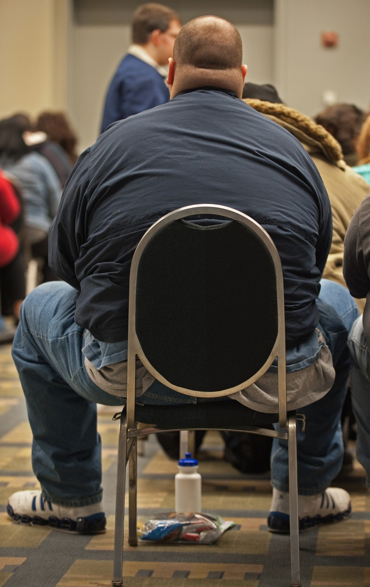 "A potential contestant sits in a waiting room with over 500 people auditioning for the popular TV show, ""The Biggest Loser"", March 6, 2010, inside the Washington Convention Center, in Washington, DC.  ""The Biggest Loser"", where contestants compete to lose weight has become a worldwide hit, airing in over 90 countries and produced in 25 countries. Since its debut in 2004, ""The Biggest Loser"" has grown to become a standalone health and lifestyle brand with tools and products inspired by the show and approved by its doctors and experts.    AFP Photo/Paul J. Richards (Photo credit should read PAUL J. RICHARDS/AFP/Getty Images)"