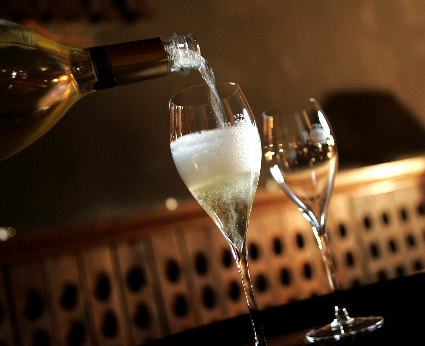 A glass of Champagne is served for a tasting, on December 11, 2008 at the producer Ruinart's cellars in Reims, northeastern France. The once sparkling shipments of France's premium export Champagne have dropped 4,9% during the first 10 months of the year, according to professionnals, but strong sales continue in emerging countries. AFP PHOTO ALAIN JULIEN (Photo credit should read ALAIN JULIEN/AFP/Getty Images)