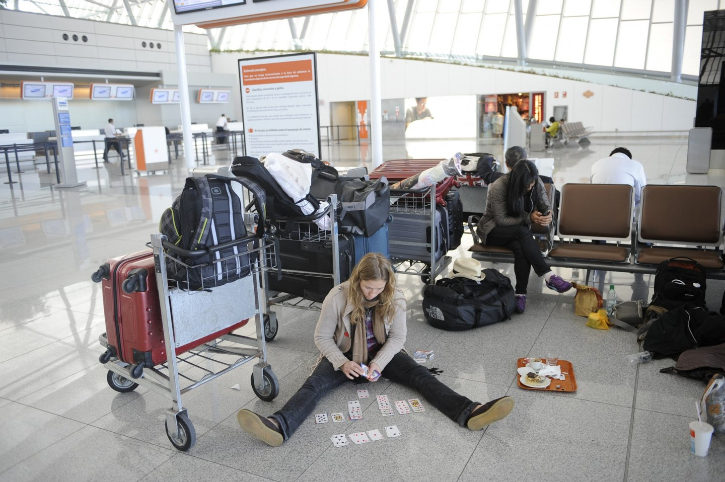 Stranded tourists await at Carrasco international airport in Montevideo, on June 10, 2011. Flights from major airports across a large section of south America were canceled Friday as ash from Chile's Puyehue volcano spread across the region, nearly one week after the volcano erupted for the first time in half a century. Flights from airports in Buenos Aires, Montevideo, and southern Brazilian cities were grounded due to clouds of ash high in the sky. Flights from airports in Buenos Aires, Montevideo, and southern Brazilian cities were grounded due to clouds of ash high in the sky. AFP PHOTO/Miguel ROJO (Photo credit should read MIGUEL ROJO/AFP/Getty Images)