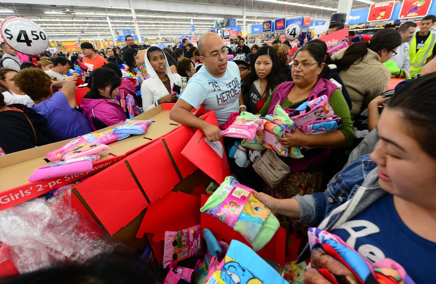 People get an early start on Black Friday shopping deals at a Walmart Superstore on November 22, 2012 in Rosemead, California, as many retailers stayed opened during the Thanksgiving celebrations, evidence that even this cherished American family holiday is falling prey to the forces of commerce. AFP PHOTO / Frederic J. BROWN (Photo credit should read FREDERIC J. BROWN/AFP/Getty Images)