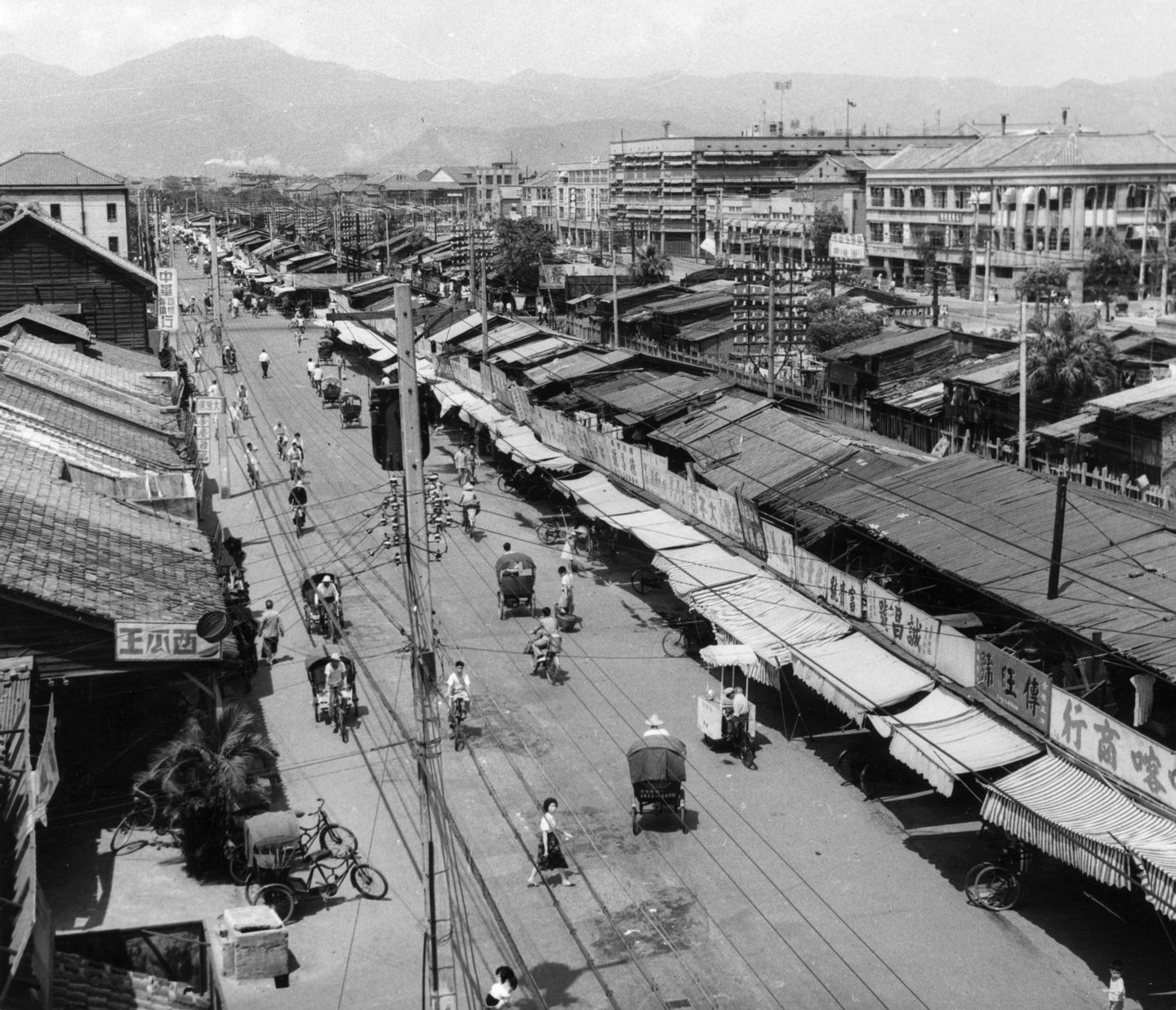 Circa 1955: Shops on Chung Hwa Road, Taipei, Taiwan (Formosa), built mostly after 1949 by Chinese refugees from the mainland. The more solid buildings on the right were built by the Japanese during their occupation of the island (from 1895 to 1945). (Photo by Three Lions/Getty Images)