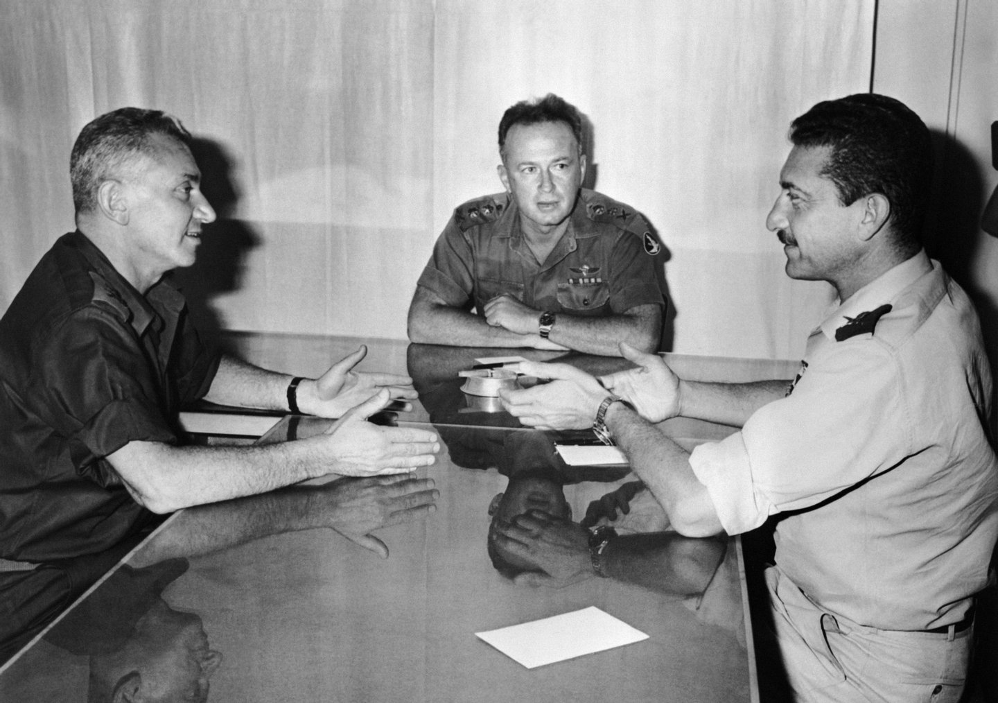 """(from L to R) Israeli Deputy Chief of Staff in the the Israel Defense Forces (IDF) Haim """"Kidoni"""" Bar-Lev, General and chief of staff of the IDF Yitzhak Rabin and General and IDF's Deputy Chief of Staff Ezer Weitzmann talk on June 6, 1967 about the military operation during the Six-Day War. AFP PHOTO (Photo credit should read DERZI/AFP/Getty Images)"""