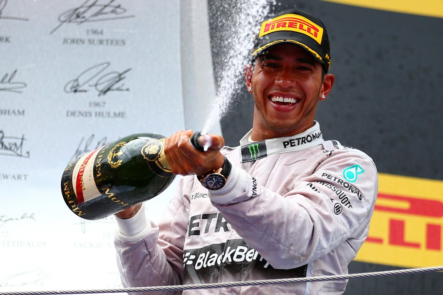 MONTMELO, SPAIN - MAY 11: Race winner Lewis Hamilton of Great Britain and Mercedes GP sprays champagne as he celebrates on the podium during the Spanish Formula One Grand Prix at Circuit de Catalunya on May 11, 2014 in Montmelo, Spain. (Photo by Dan Istitene/Getty Images)