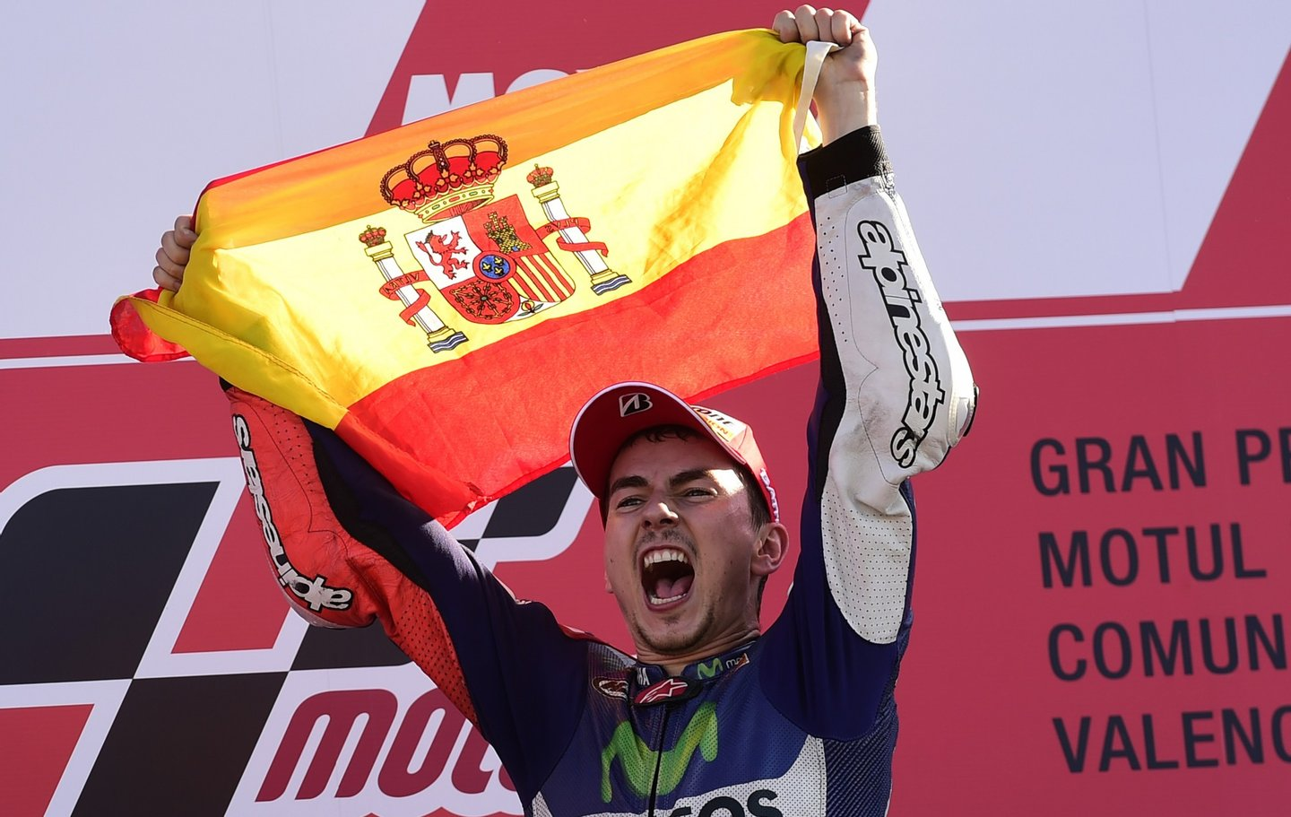 Movistar Yamaha's Spanish rider Jorge Lorenzo celebrates on the podium winning the race and the 2015 MotoGP world championship tiltle after the MotoGP motorcycling race at the Valencia Grand Prix at Ricardo Tormo racetrack in Cheste, near Valencia on November 8, 2015. AFP PHOTO / JAVIER SORIANO (Photo credit should read JAVIER SORIANO/AFP/Getty Images)
