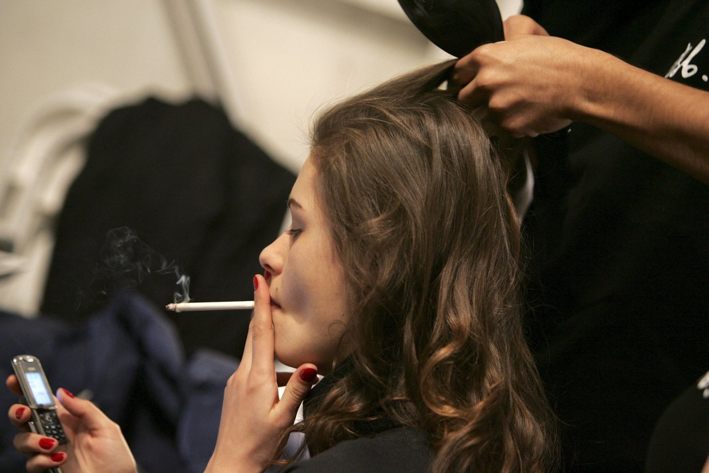 NEW YORK - FEBRUARY 07: A model smokes backstage at the Chaiken Fall 2006 fashion show during Olympus Fashion Week at Bryant Park February 6, 2006 in New York City. (Photo by Paul Hawthorne/Getty Images)