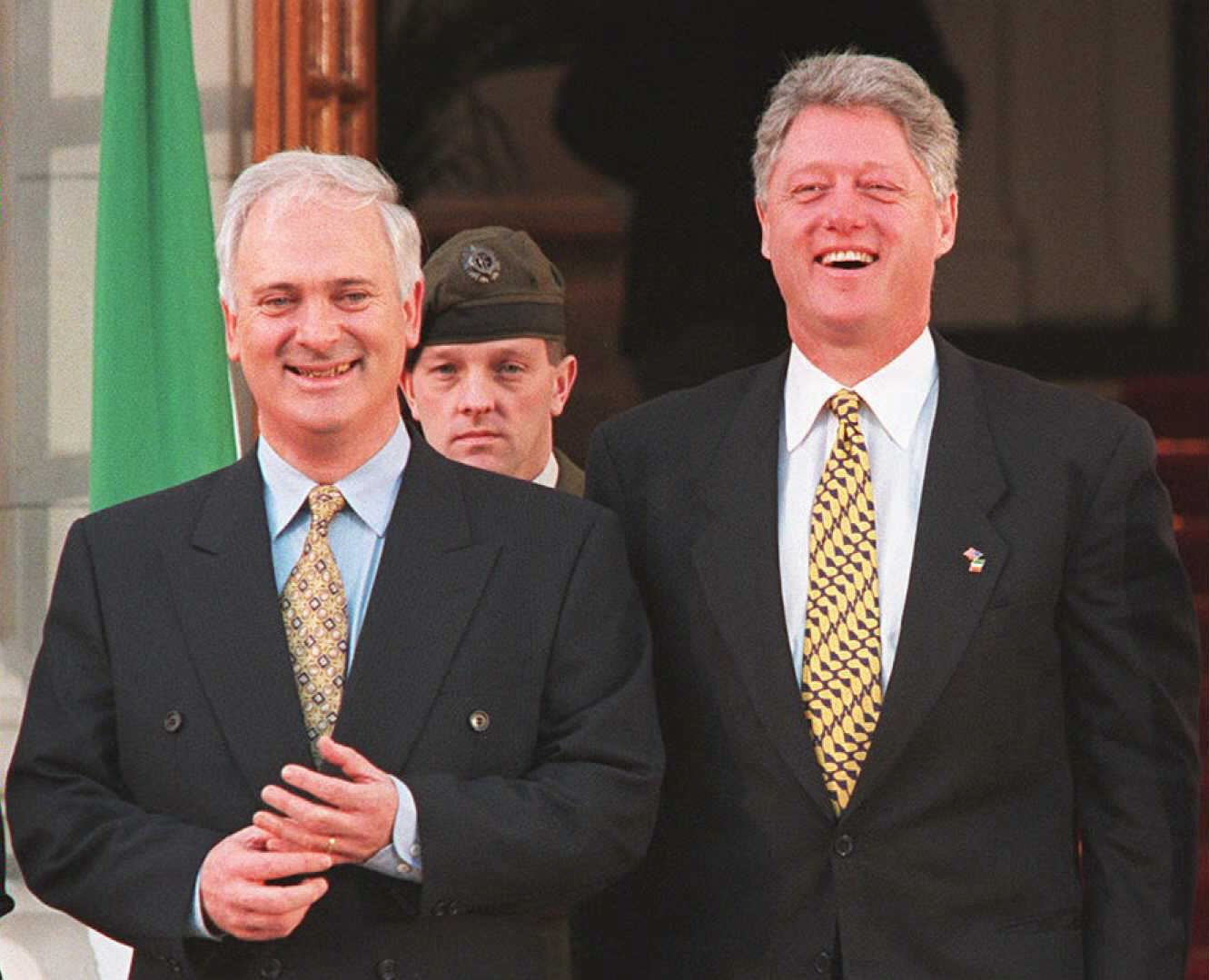 DUBLIN, IRELAND - DECEMBER 1: US President Bill Clinton (R) laughs with Irish Prime Minister John Bruton (L) 01 December before a meeting in which they discussed Bosnia and the Northern Ireland peace process. Clinton is on the first day of a two-day visit to Ireland. AFP PHOTO (Photo credit should read PATRICK KOVARIK/AFP/Getty Images)