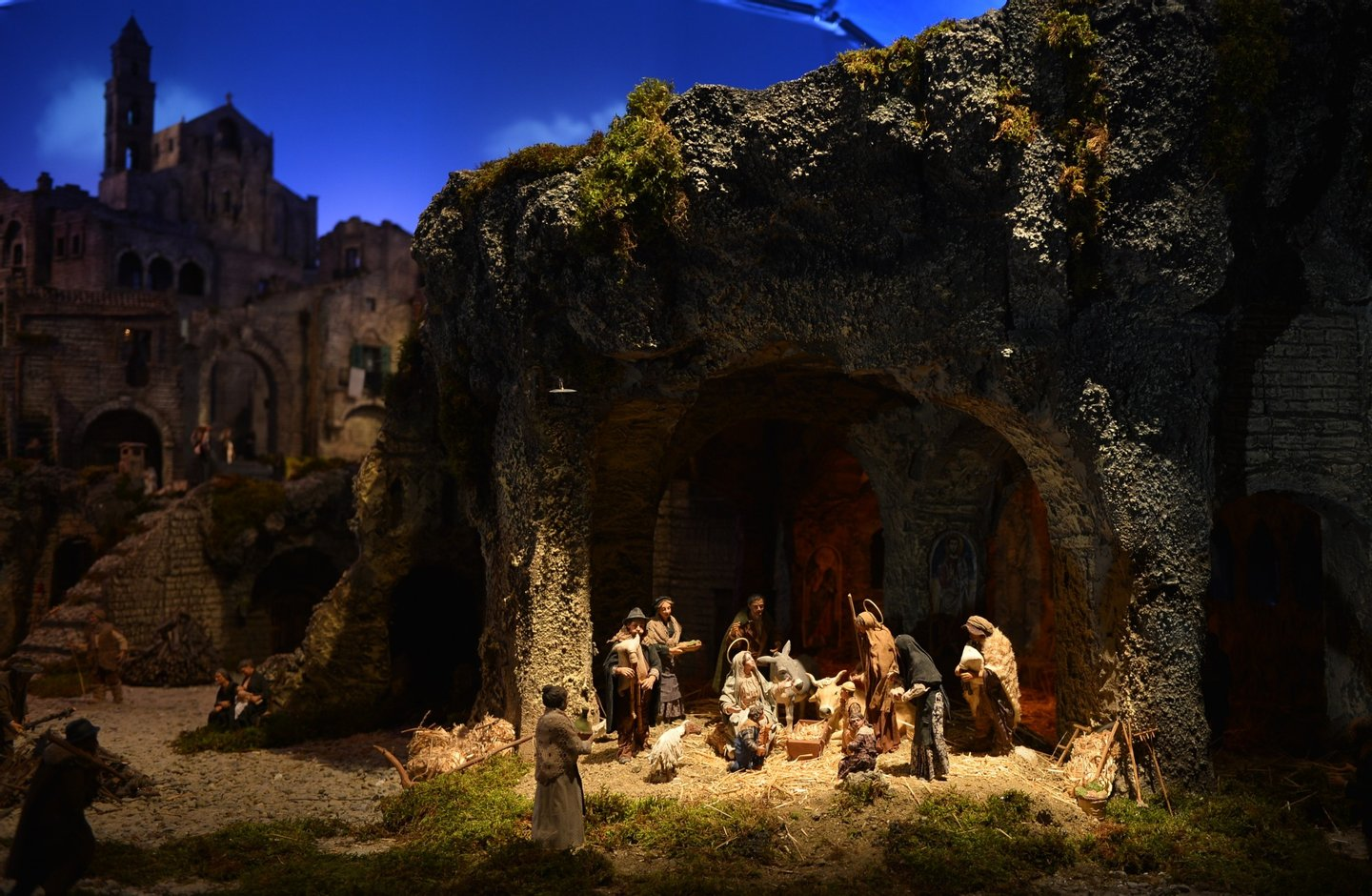 This picture taken on December 24, 2012 shows the crib in St Peter's Square at the Vatican, at the end of the unveiling ceremony. Pope Benedict XVI will celebrate a late Christmas night holy mass at St. Peter's Basilica to mark the nativity of Jesus Christ. AFP PHOTO / VINCENZO PINTO (Photo credit should read VINCENZO PINTO/AFP/Getty Images)