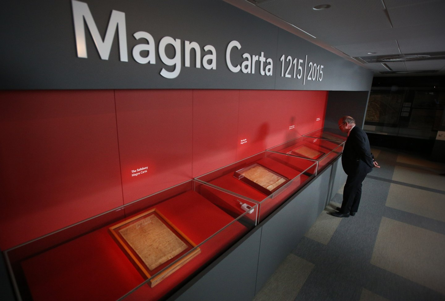 LONDON, ENGLAND - FEBRUARY 02: A visitor looks at one of the four copies of the Magna Carta on display at the British Library on February 2, 2015 in London, England. Magna Carta, one of the world's most influential documents, is an agreement granted by King John in 1215 as a practical solution to a political crisis, which in the centuries since has become a potent symbol of liberty and the rule of law. The British Library, Lincoln Cathedral and Salisbury Cathedral have brought those four original surviving Magna Carta manuscripts together in one place, for the first time as part of a year of international celebrations to mark the 800th anniversary of the issue of the Charter by King John in 1215. (Photo by Peter Macdiarmid/Getty Images)