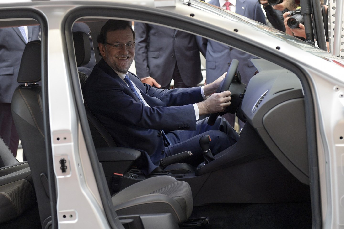 Spanish Prime Minister Mariano Rajoy smiles as he sits in a Seat car during a visit to the SEAT motor vehicle plant in Martorell near Barcelona on September 8, 2015 to celebrate the 40th anniversary of the plant's technical centre. AFP PHOTO / JOSEP LAGO (Photo credit should read JOSEP LAGO/AFP/Getty Images)