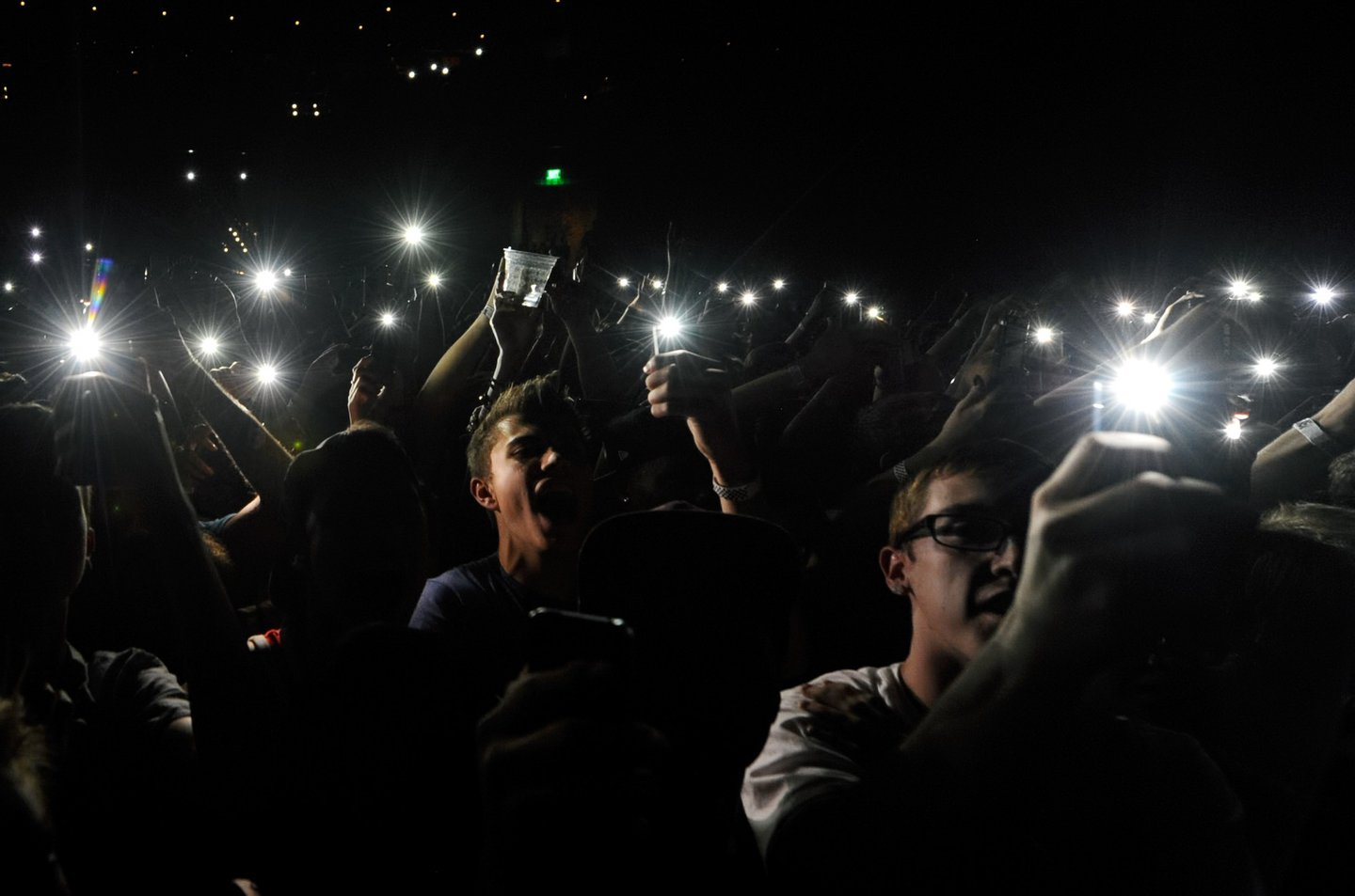 """LAS VEGAS, NV - MAY 02: Fans hold up phones with lights as actor/comedian Donald Glover as recording artist Childish Gambino performs at The Chelsea at The Cosmopolitan of Las Vegas during his Deep Web tour in support of the album """"because the internet"""" on May 2, 2014 in Las Vegas, Nevada. (Photo by Ethan Miller/Getty Images)"""
