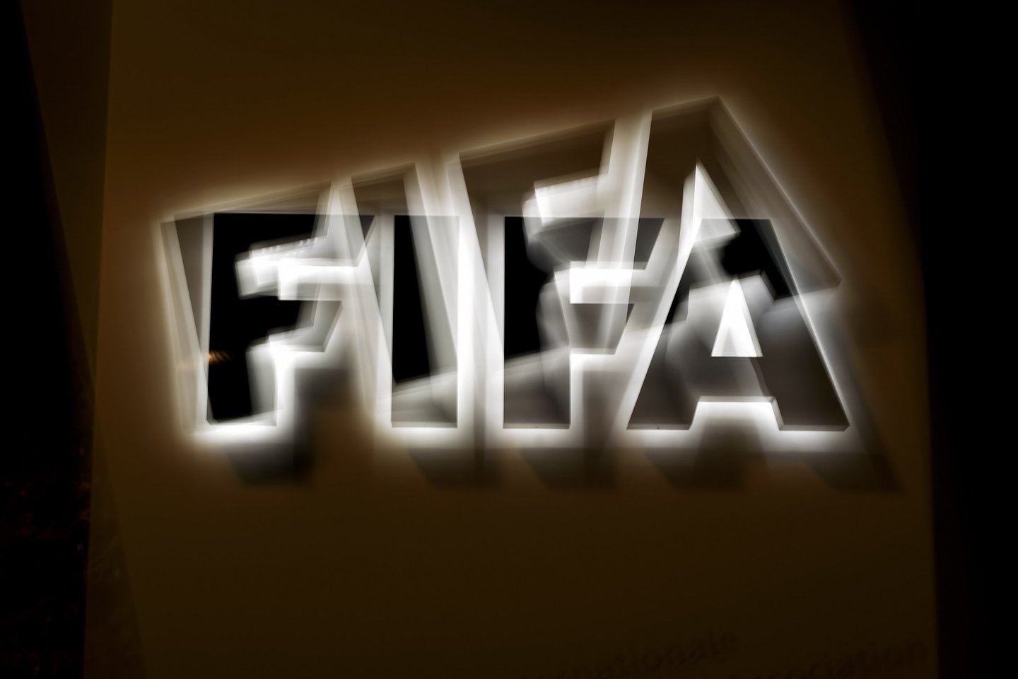 This long exposure photo taken on October 8, 2015 shows the FIFA logo at the entrance sign of the FIFA world headquarters in Zurich. FIFA's ethics watchdog on Thursday suspended the two most powerful men in football, Sepp Blatter and Michel Platini, for 90 days in a sensational new blow to the sport's scandal-tainted governing body. Issa Hiyatou head of the Confederation of African Football, a Blatter ally, was put in charge of the multi-billion dollar body. AFP PHOTO / FABRICE COFFRINI (Photo credit should read FABRICE COFFRINI/AFP/Getty Images)