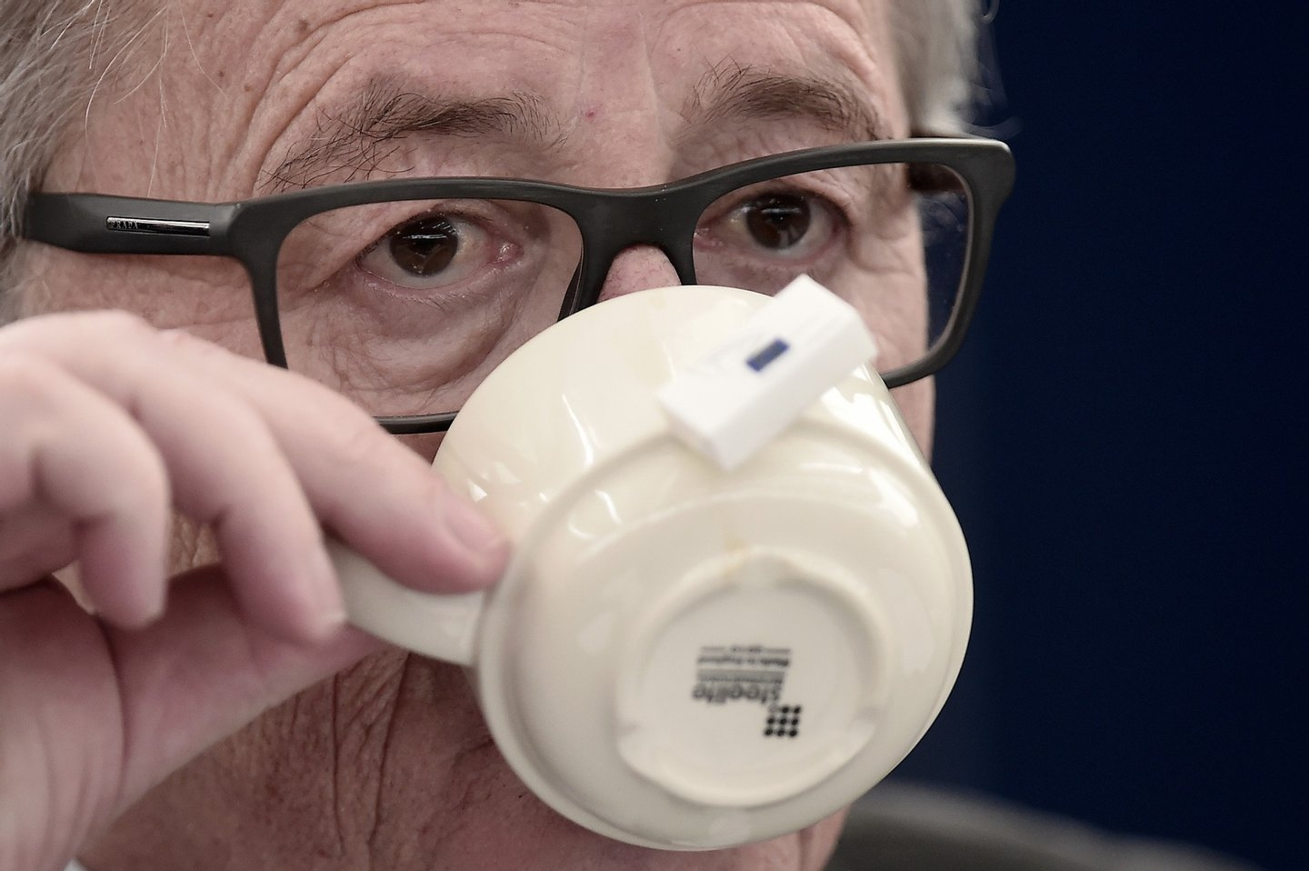 European Commission's President Jean-Claude Juncker takes a drink as he attends a debate on the 13 November terrorist attacks in Paris and subsequent police and military operations at the European Parliament in Strasbourg, eastern France, on November 25, 2015. AFP PHOTO/FREDERICK FLORIN / AFP / FREDERICK FLORIN (Photo credit should read FREDERICK FLORIN/AFP/Getty Images)