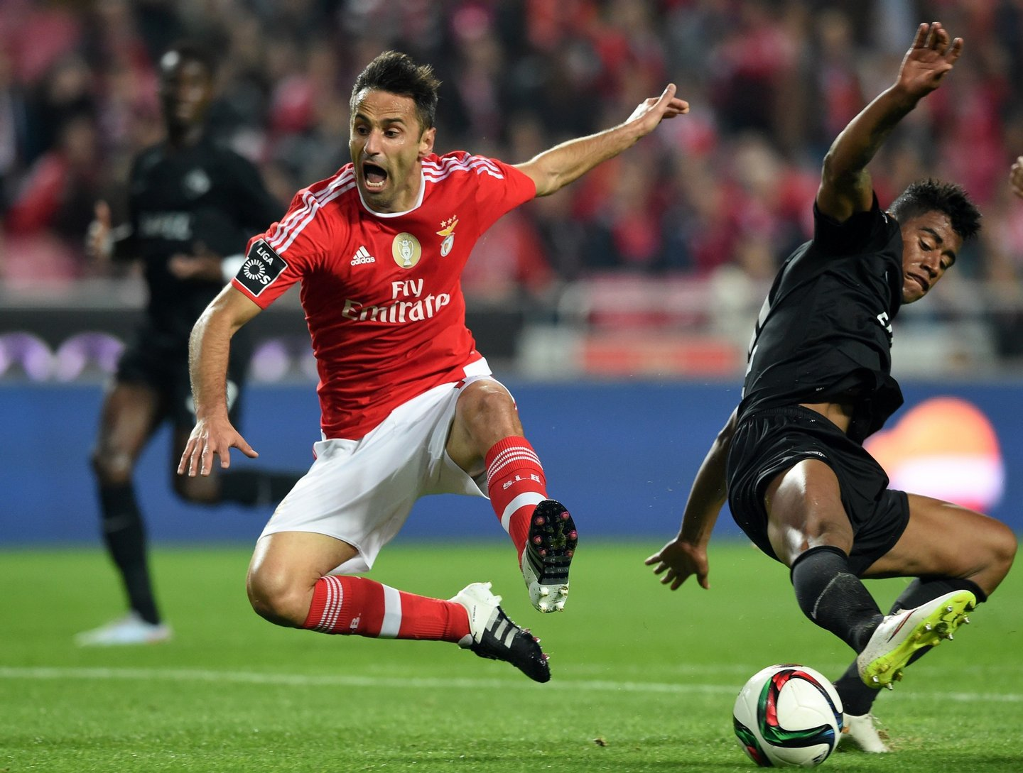 Benfica's Brazilian forward Jonas (L) vies with Academica Coimbra's Brazilian defender Iago Santos during the Portuguese league football match SL Benfica vs Ass Academica de Coimbra at the Luz stadium in Lisbon on December 4, 2015. AFP PHOTO/ FRANCISCO LEONG / AFP / FRANCISCO LEONG (Photo credit should read FRANCISCO LEONG/AFP/Getty Images)