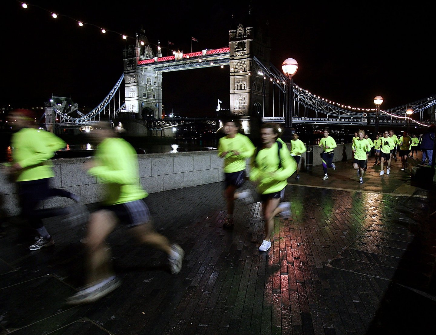 LONDON - NOVEMBER 28: Runners head past Tower Bridge during the Nike Run London 10k race on November 28, 2004 in London, England. (Photo by John Gichigi/Getty Images)