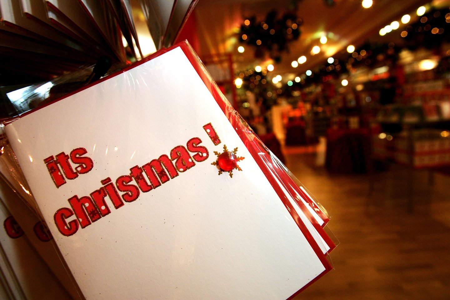 LONDON - AUGUST 07: Christmas cards are displayed with Christmas themed merchandise at Harrods in Knightsbridge for the launch of the store's 'Christmas World' on August 7, 2007 in London, England. (Photo by Rosie Greenway/Getty Images)