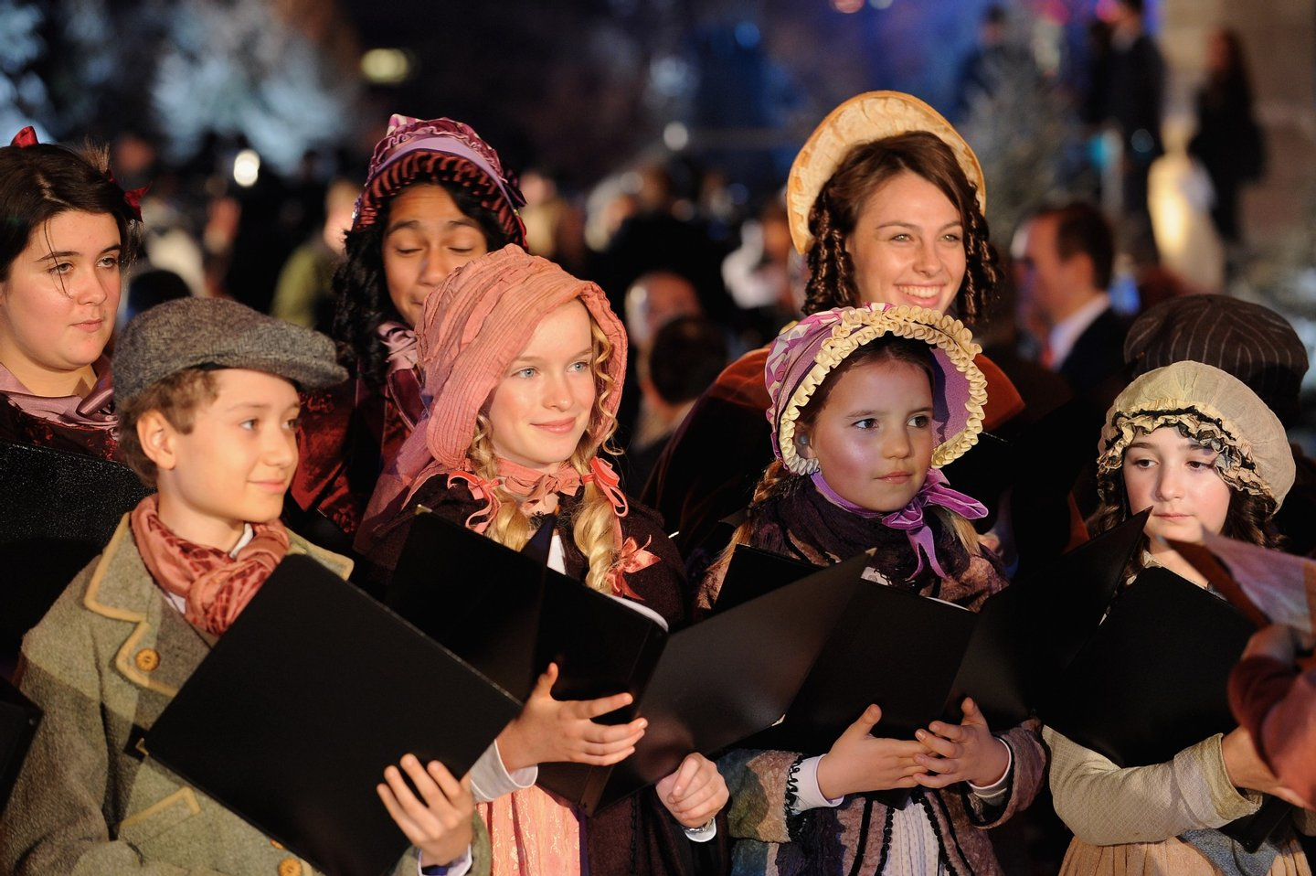 LONDON, ENGLAND - NOVEMBER 03: A choir sings christmas carols during for the World Film Premiere of Disney's 'A Christmas Carol' at the Odeon Leicester Square on November 3, 2009 in London, England. (Photo by Ian Gavan/Getty Images for Disney)