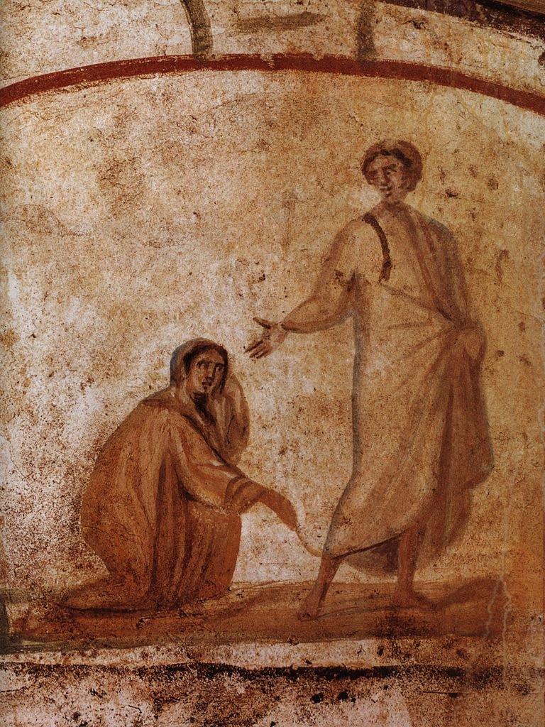 Um dos primeiros exemplos conhecidos de arte cristã Jesus cura uma mulher. Roma, Catacumbas de Marcelino e Pedro, século IV