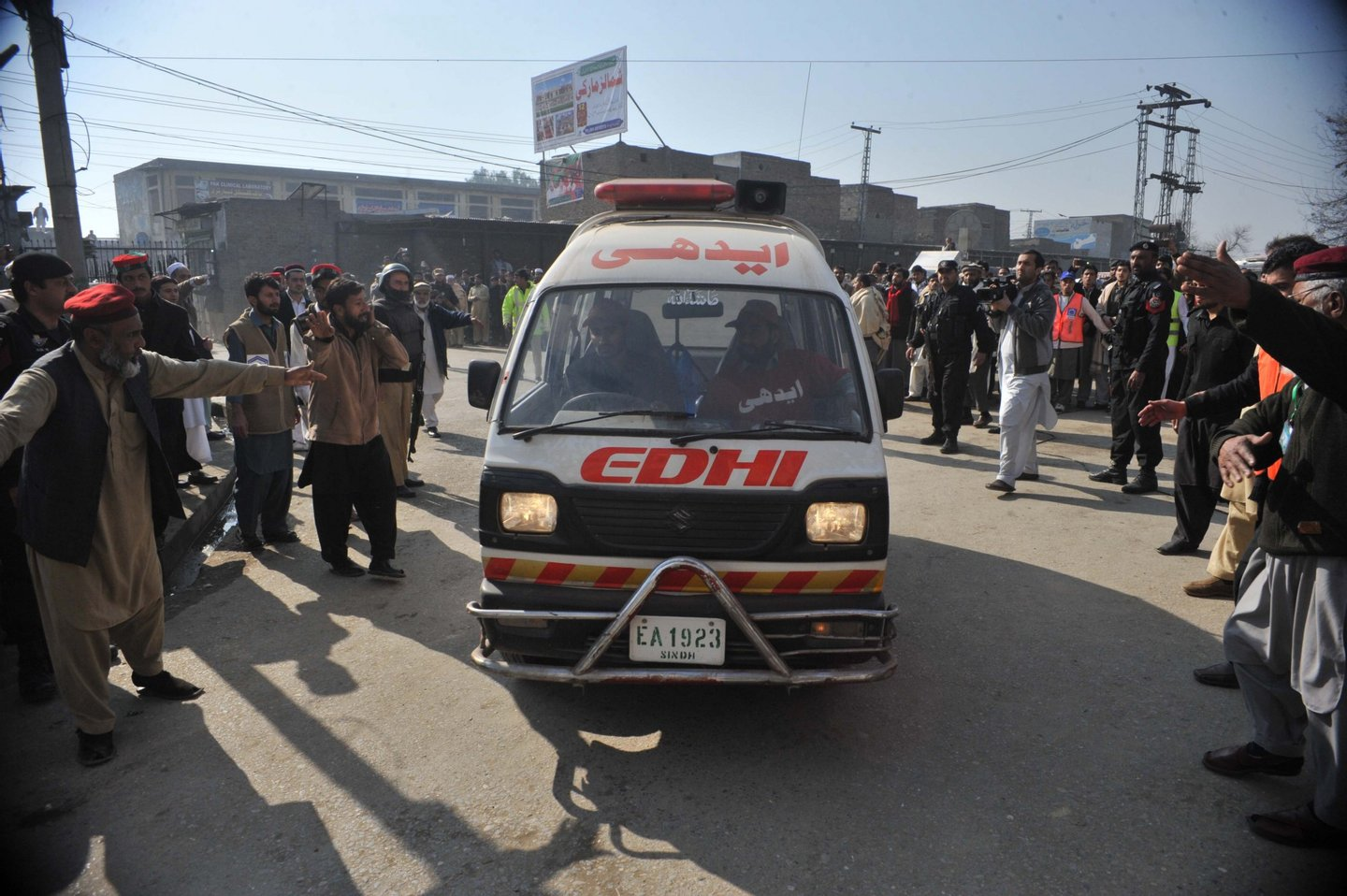An ambulance carrying injured victims enters a hospital following an attack by gunmen at Bacha Khan university in Charsadda, about 50 kilometres from Peshawar, on January 20, 2016. At least 21 people died in an armed assault on a university in Pakistan on January 20, where witnesses reported two large explosions as security forces moved in under dense fog to halt the bloodshed. AFP PHOTO / Hasham AHMED / AFP / HASHAM AHMED (Photo credit should read HASHAM AHMED/AFP/Getty Images)