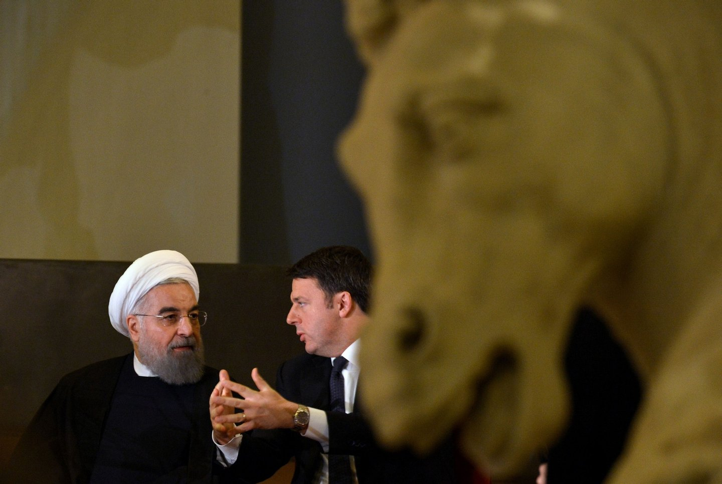Italian Prime Minister Matteo Renzi (R) speaks with Iranian President Hassan Rouhani (L) during a meeting at the Capitol Hill in Rome on January 25, 2016. Iran's return to the international fold accelerated as Rouhani sealed multi-billion dollar deals with Italian companies keen to capitalise on the lifting of sanctions on the Islamic Republic. / AFP / TIZIANA FABI (Photo credit should read TIZIANA FABI/AFP/Getty Images)