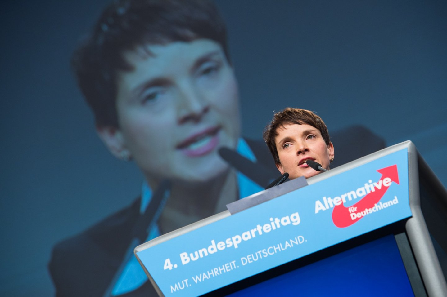 """HANOVER, GERMANY - NOVEMBER 28: Chairwoman Frauke Petry delivers her speech during the AfD (Alternative fuer Deutschland) federal party congress on November 28, 2015 in Hanover, Germany. The AFD aims to enter three new state parliaments in 2016 by luring conservative voters angry with Chancellor Angela Merkel's open-door asylum policy. This weekend the party will outline its plan to bring order to what it calls the """"asylum chaos."""" (Photo by Nigel Treblin/Getty Images)"""