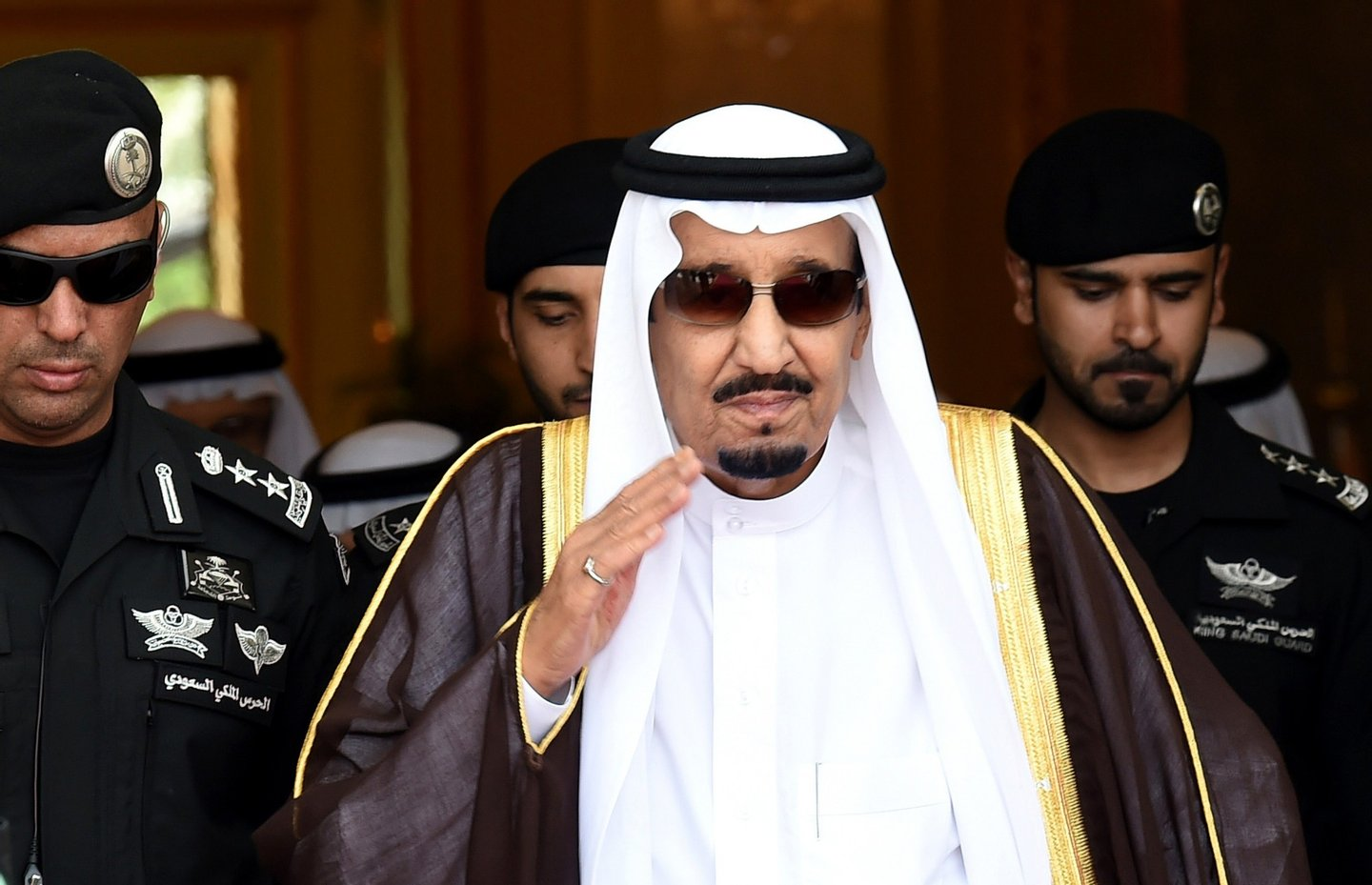 Saudi King Salman bin Abdulaziz (C) walks out to receive Sheikh Mohammed Bin Rashid al-Maktoum, ruler of Dubai (unseen) upon his arrival to attend the Gulf Cooperation Council (GCC) summit in Riyadh on May 5, 2015. AFP PHOTO / FAYEZ NURELDINE (Photo credit should read FAYEZ NURELDINE/AFP/Getty Images)