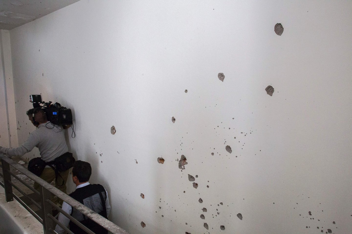 """Bullet holes on a wall in the house where five alleged gang members were killed in the military operation which resulted in the recapture of Joaquin """"El Chapo"""" Guzman, in Los Mochis city, Sinaloa State, Mexico on January 11, 2016. Mexican marines recaptured fugitive drug kingpin Joaquin """"El Chapo"""" Guzman on January 8 in the northwest of the country, six months after his spectacular prison break embarrassed authorities. AFP PHOTO/HECTOR GUERRERO / AFP / HECTOR GUERRERO (Photo credit should read HECTOR GUERRERO/AFP/Getty Images)"""
