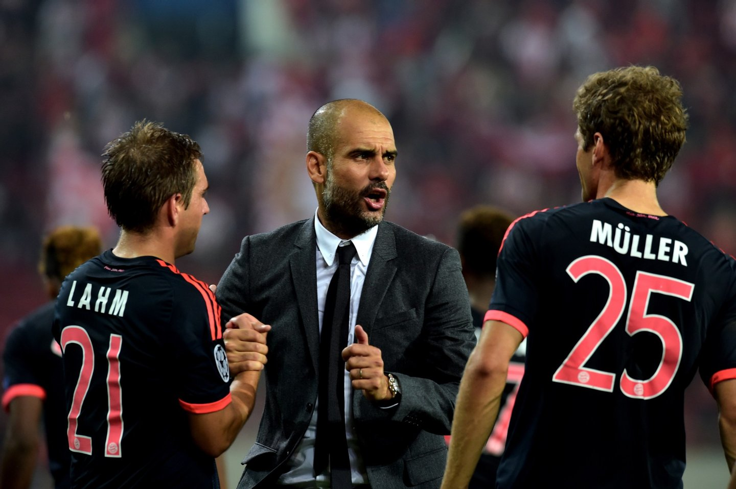 Bayern Munich's Spanish coach Josep Guardiola (C) speaks with Bayern Munich's German forward Thomas Mueller (R) after his team won against Olympiakos during the Group F Champions League football match at the Karaiskaki stadium in Athens on September 16, 2015. AFP PHOTO / ARIS MESSINIS (Photo credit should read ARIS MESSINIS/AFP/Getty Images)