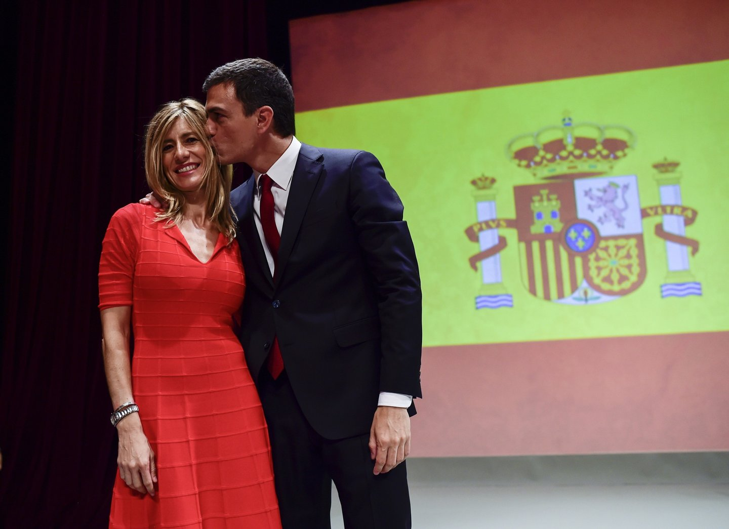 Secretary general of Spanish Socialist Party (PSOE) Pedro Sanchez (R) kisses his wife Begona Fernandez after delivering a speech during his official presentation as PSOE candidate for next general elections, at the Price Circus in Madrid on June 21, 2015. AFP PHOTO/ DANI POZO (Photo credit should read DANI POZO/AFP/Getty Images)