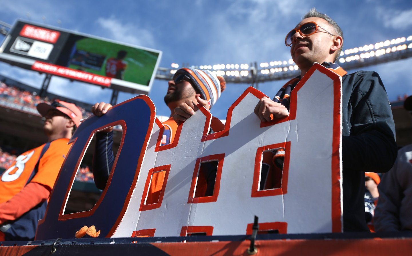 DENVER, CO - JANUARY 24: Fans hold a 'defense' sign prior to the AFC Championship game between the New England Patriots and the Denver Broncos at Sports Authority Field at Mile High on January 24, 2016 in Denver, Colorado. (Photo by Doug Pensinger/Getty Images)